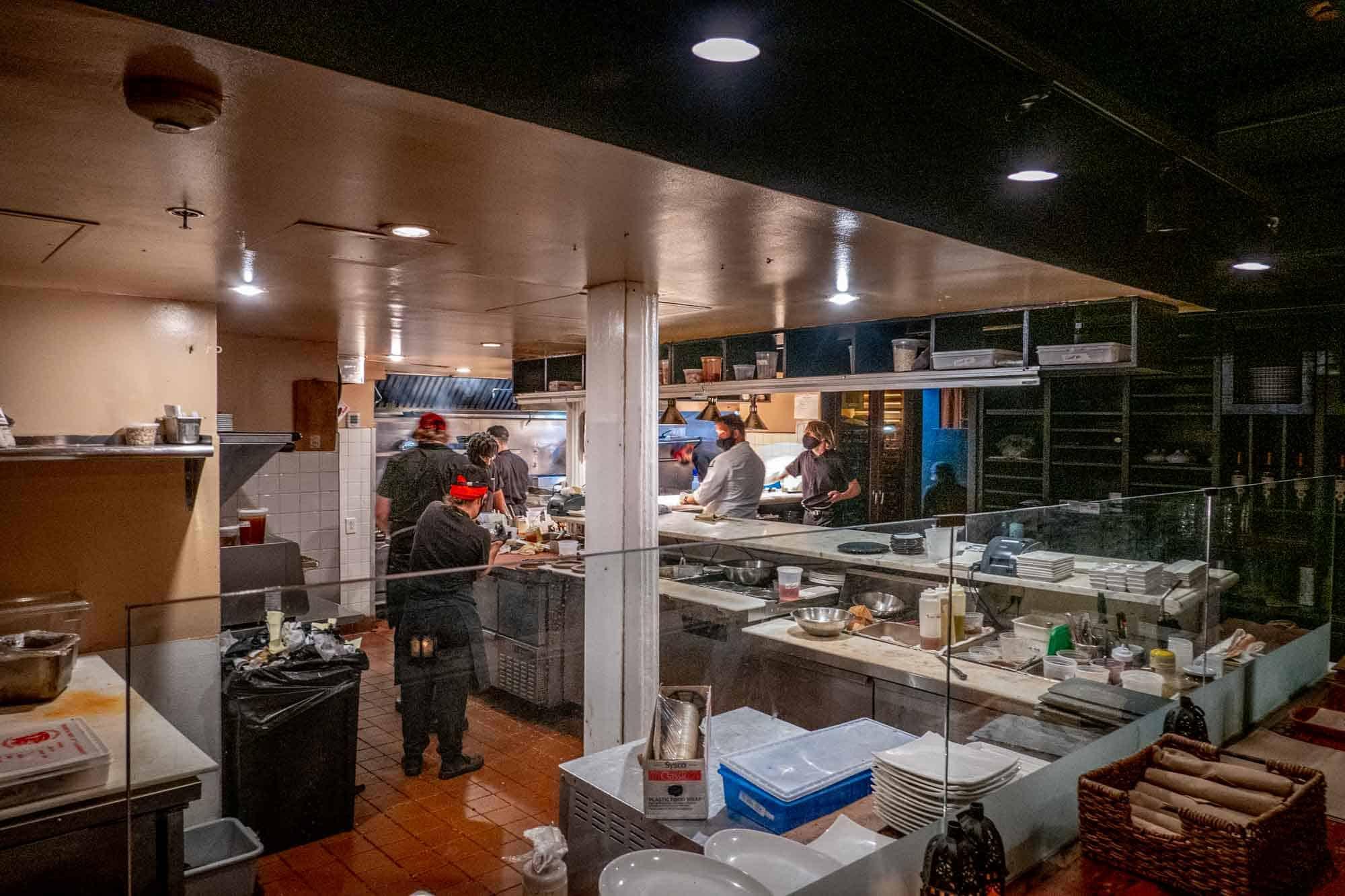 Employees in open restaurant kitchen