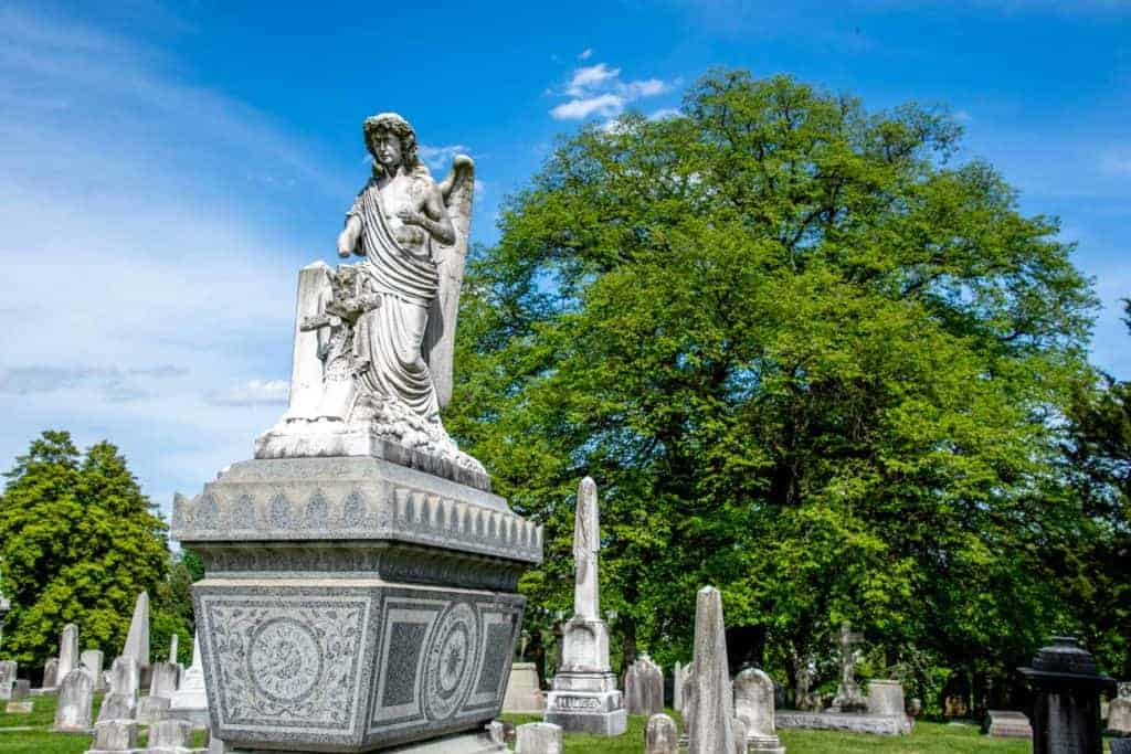 Angel sculpture on a gray tomb at Laurel Hill Cemetery