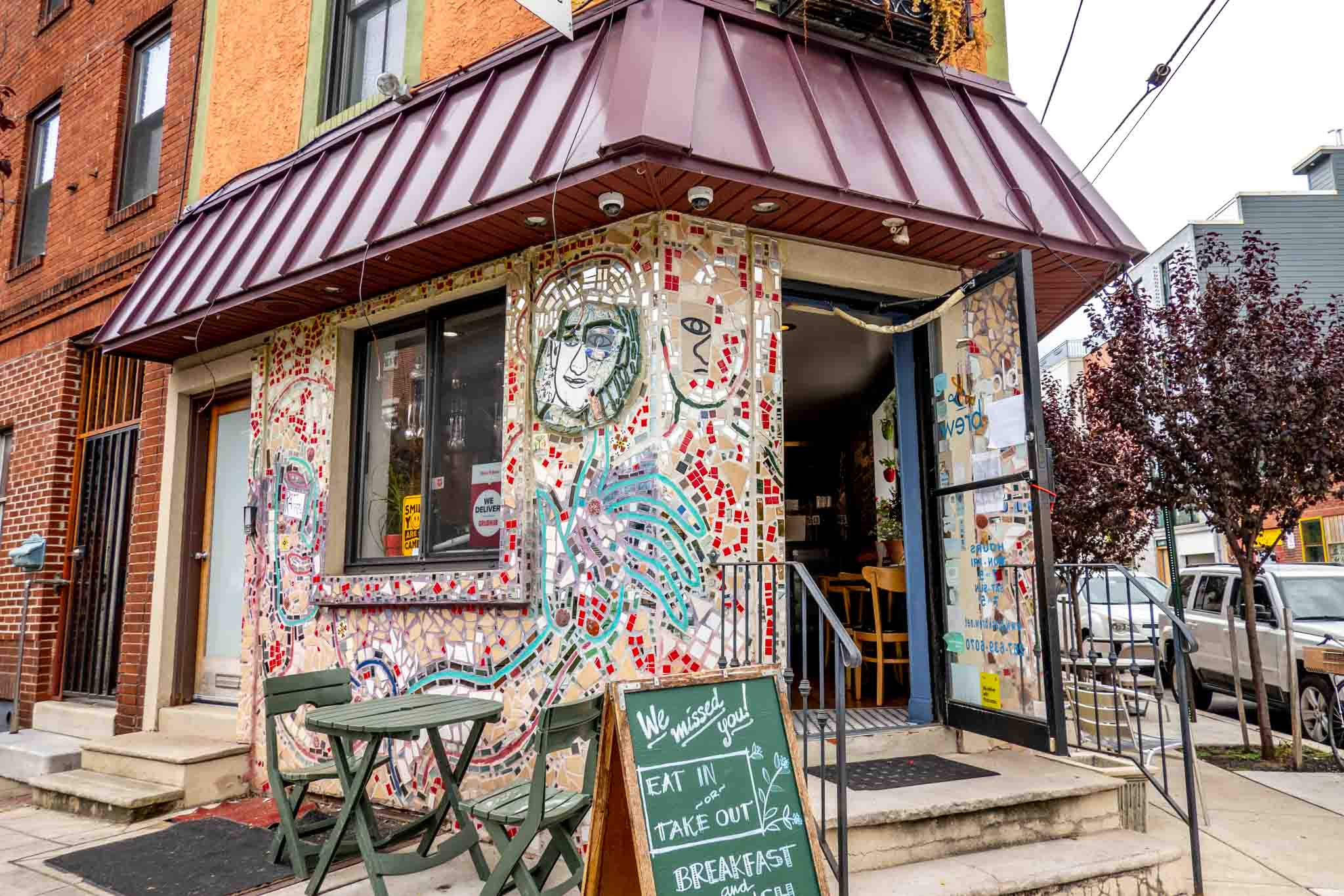 Cafe exterior covered in multi-colored mosaic tiles