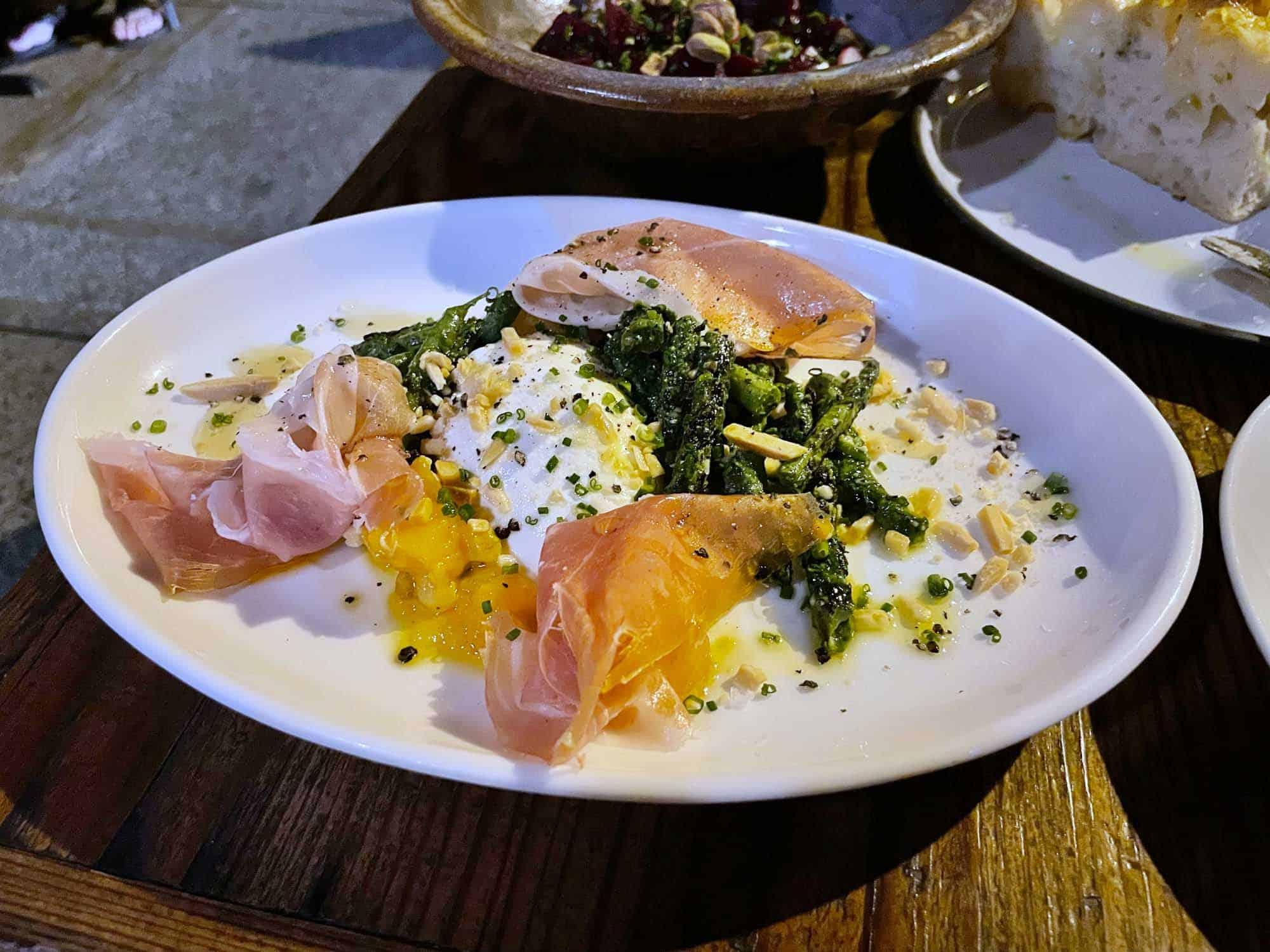 Burrata and prosciutto on plate