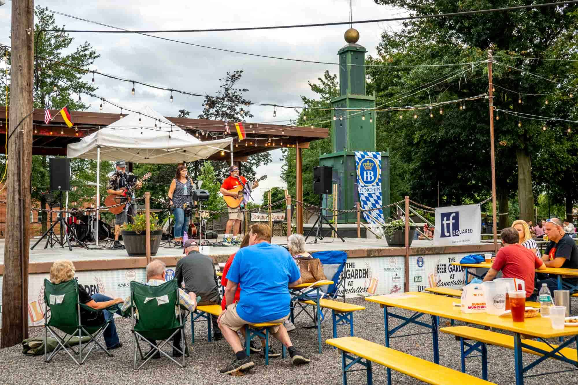 Musicians on a stage in a beer garden