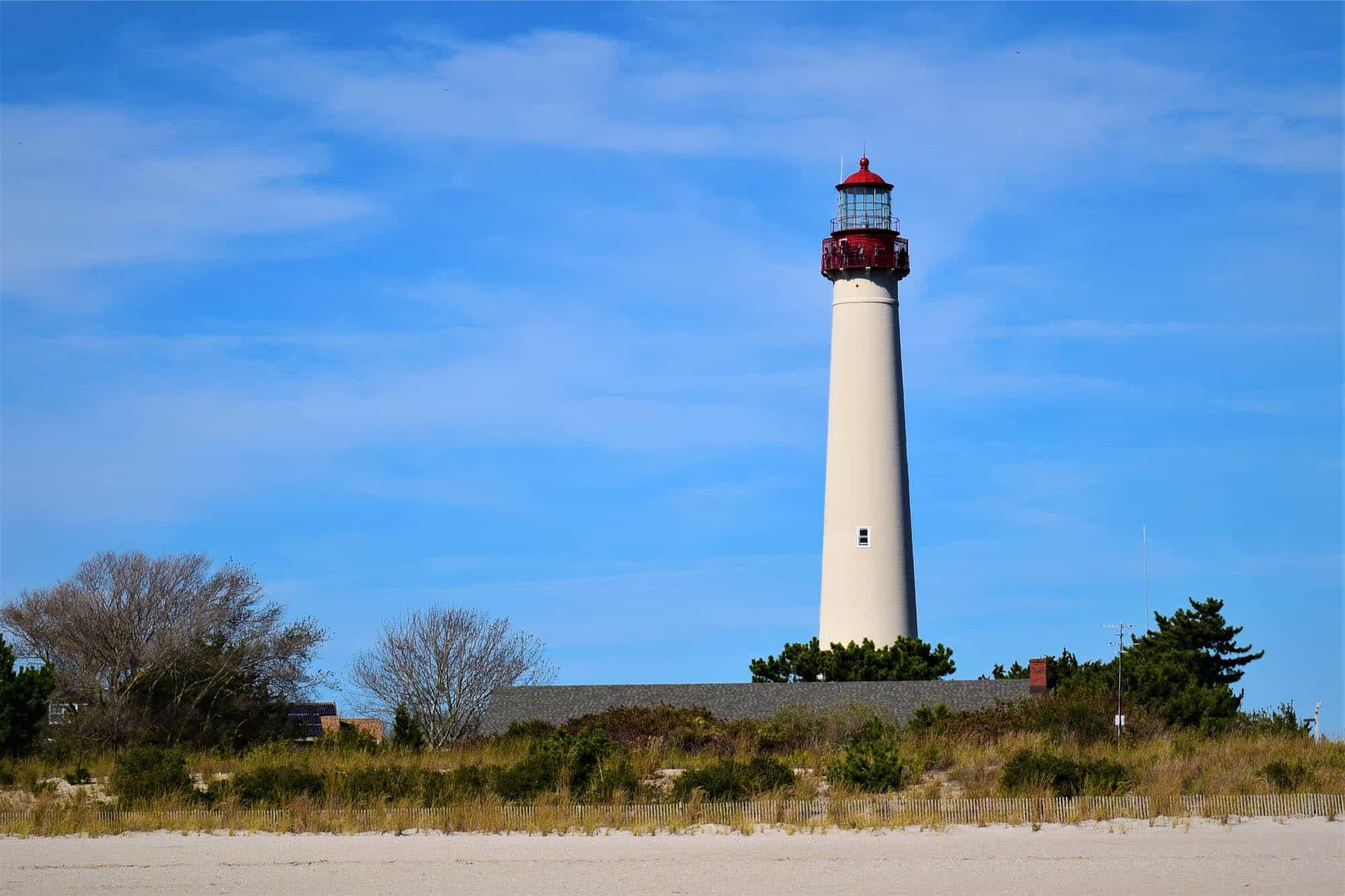 Cape May Lighthouse above sandy beach