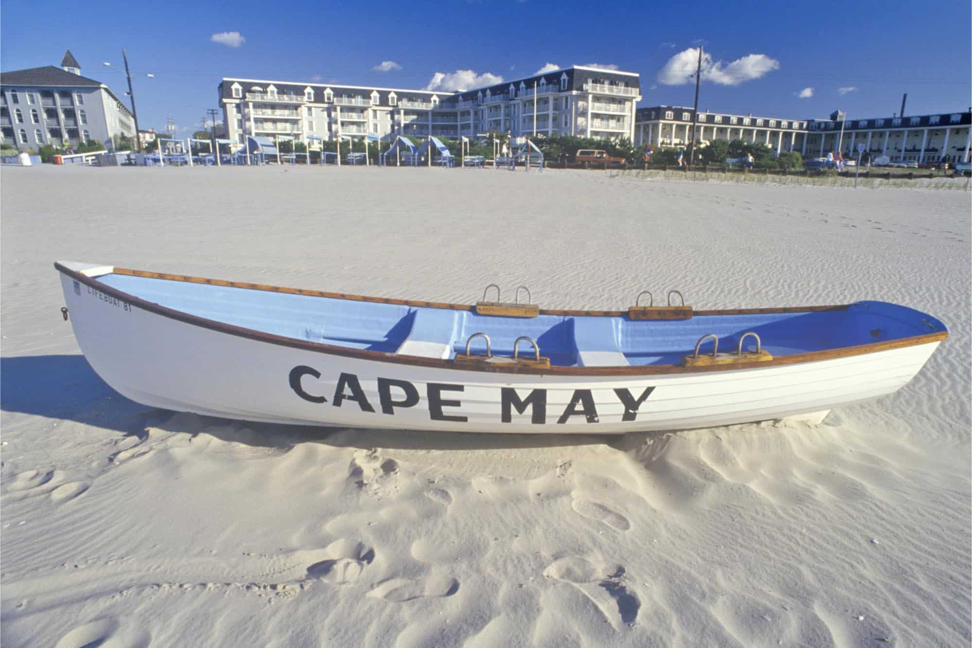 White lifeboat on sandy beach