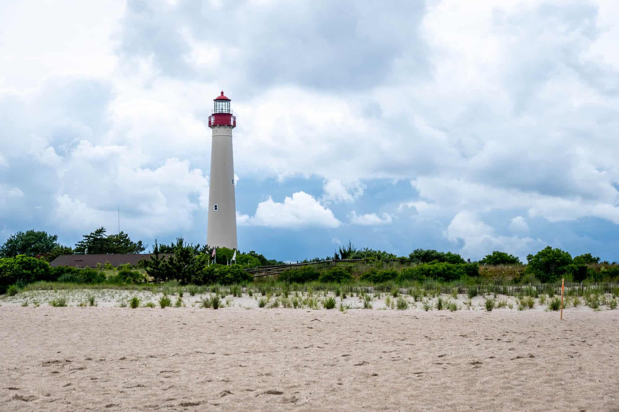 Lighthouse above sandy beach