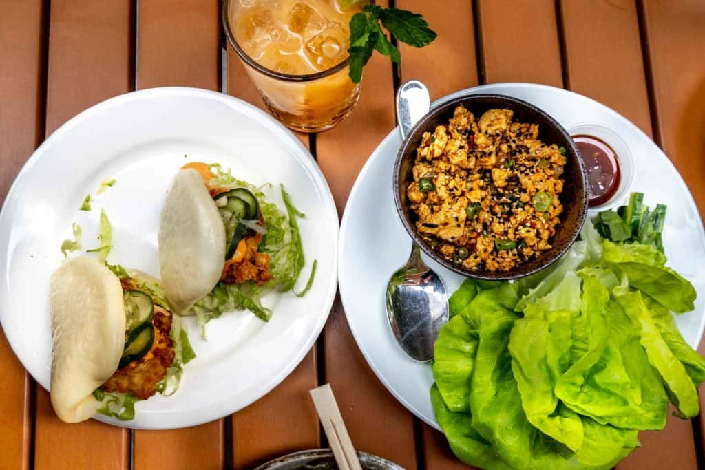 Asian food of chicken buns and lettuce wraps with cocktail at a Fishtown restaurant