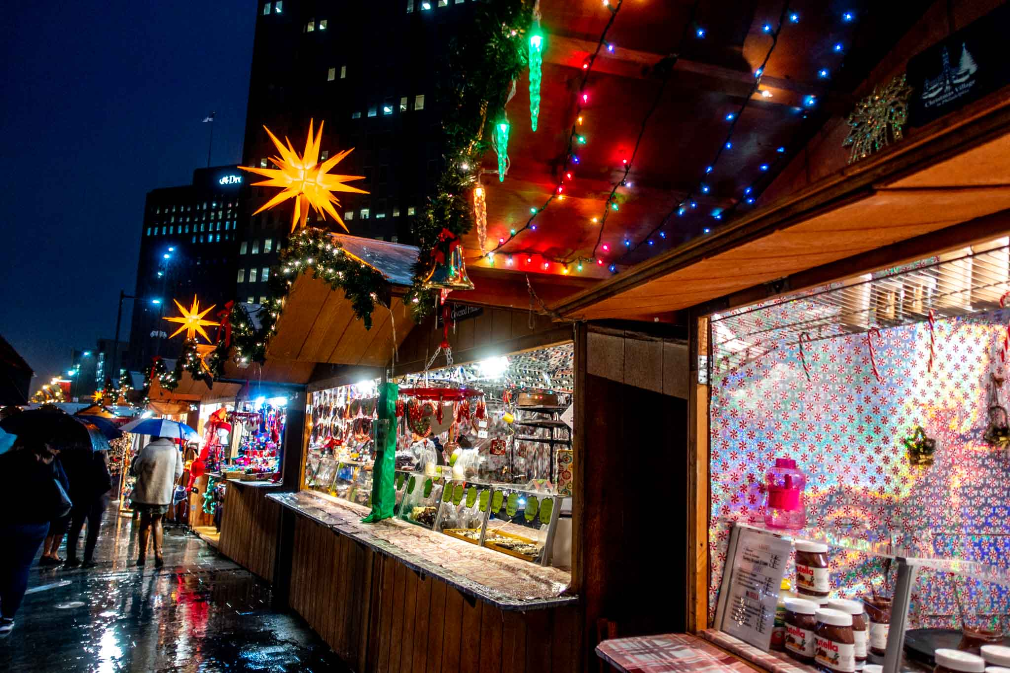 Wooden vendor huts decorated with lights