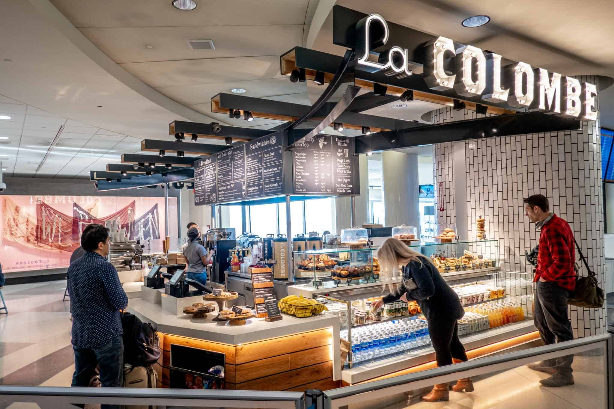 Customers buying food and drinks at La Colombe coffee bar