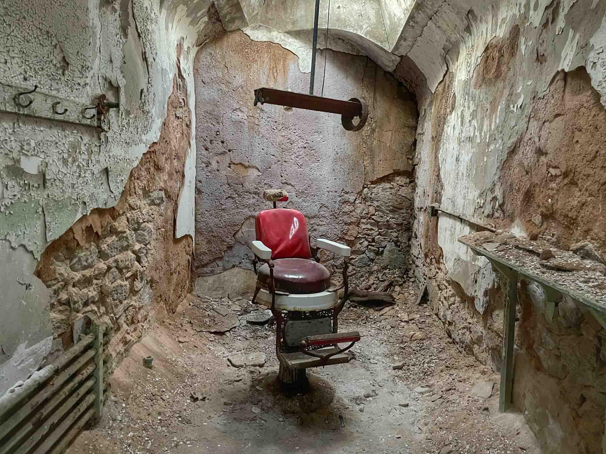 Barber chair in debris-filled room