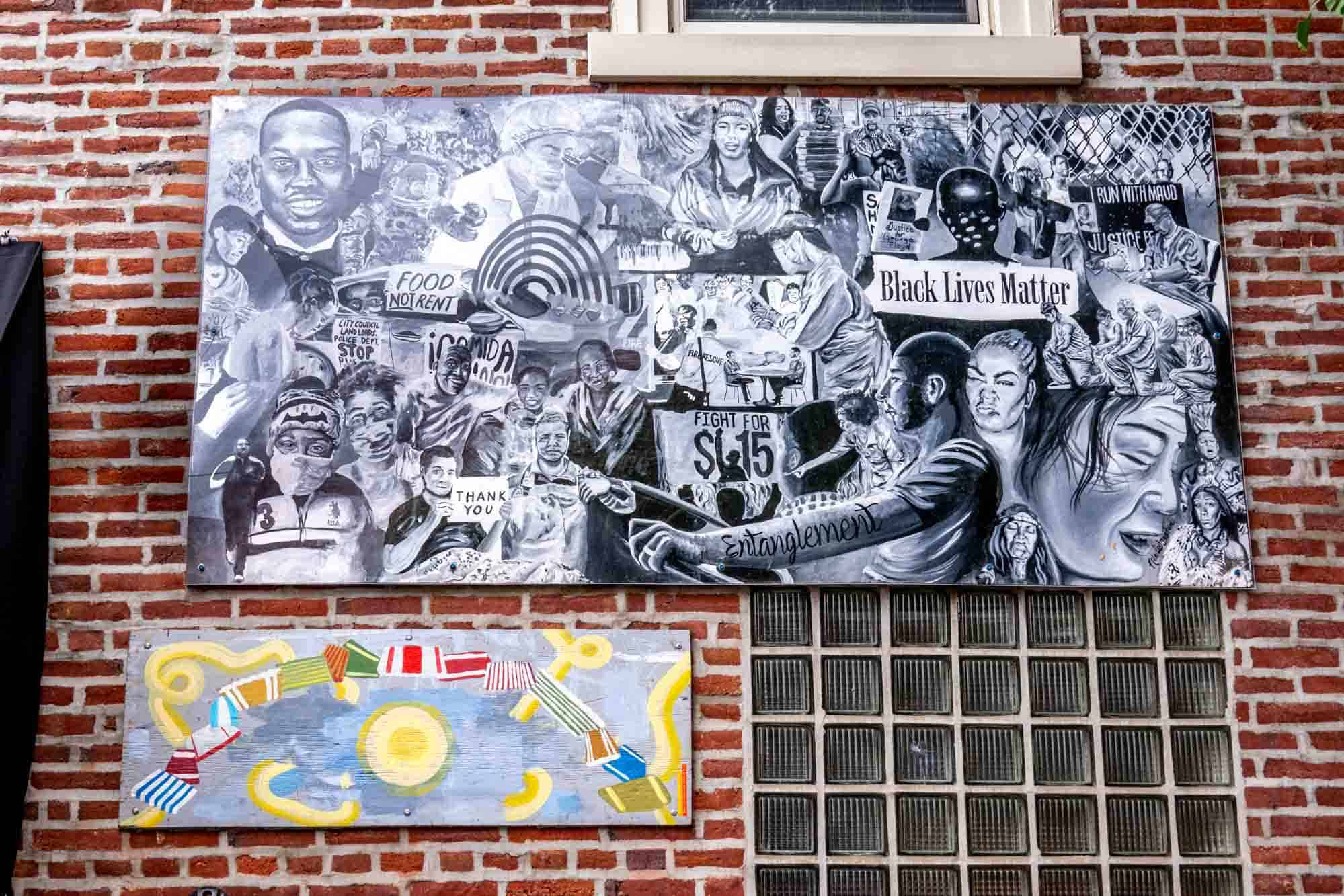 Black and white mural of people with phrases of social consciousness and political action included