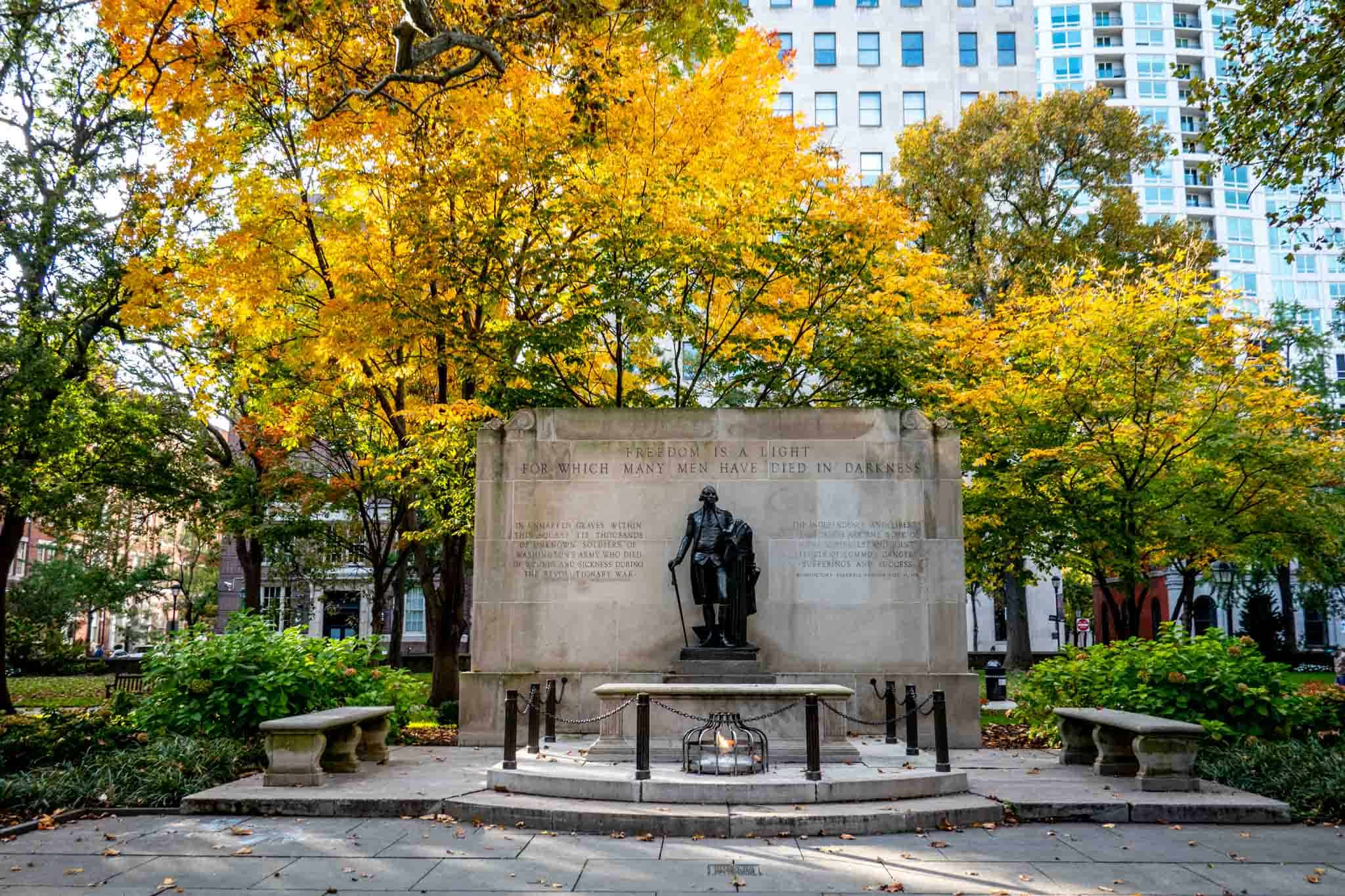 Monument surrounded by fall foliage in a park