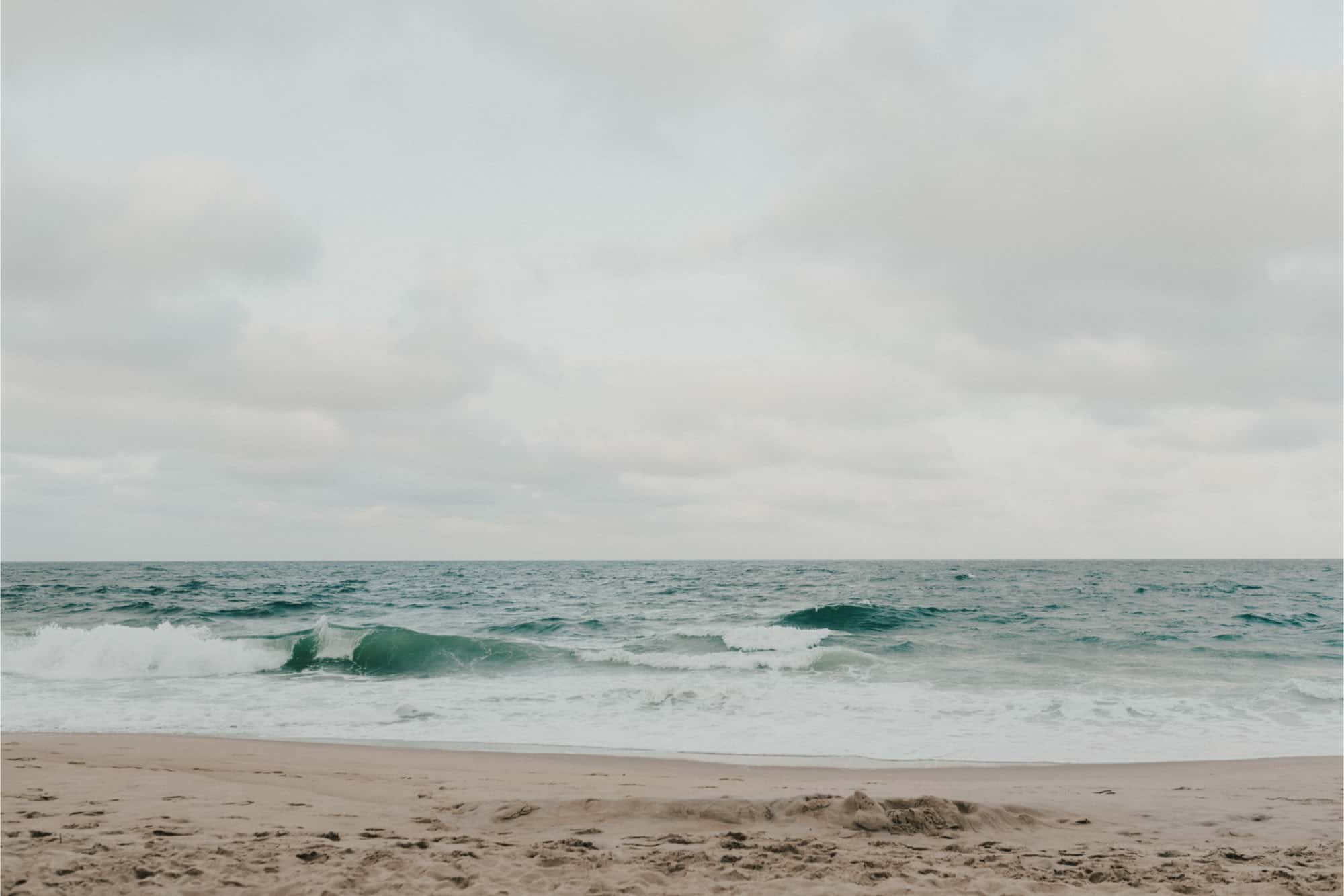 Waves crashing on sandy beach