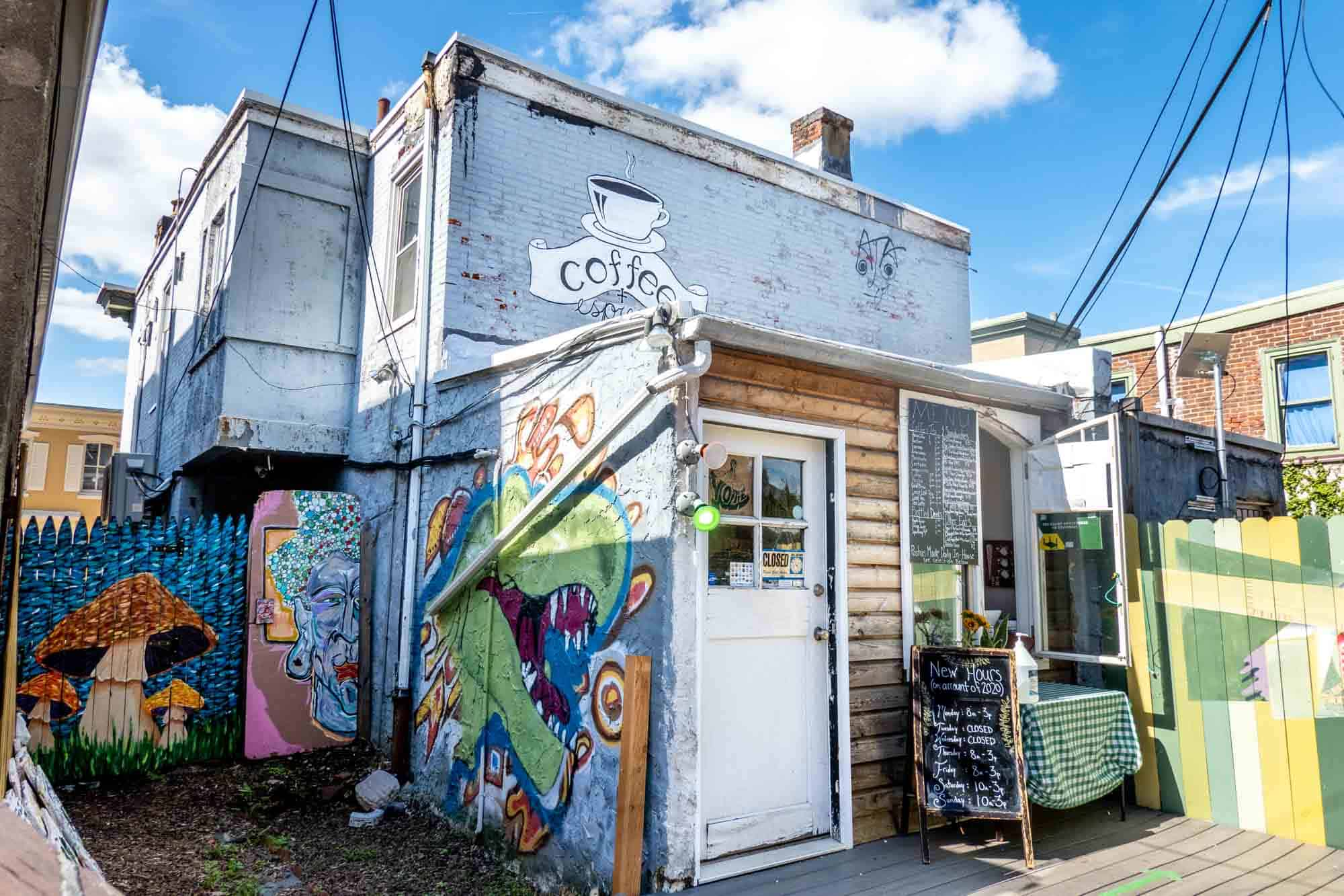 Exterior of a small cafe with colorful murals on the outside