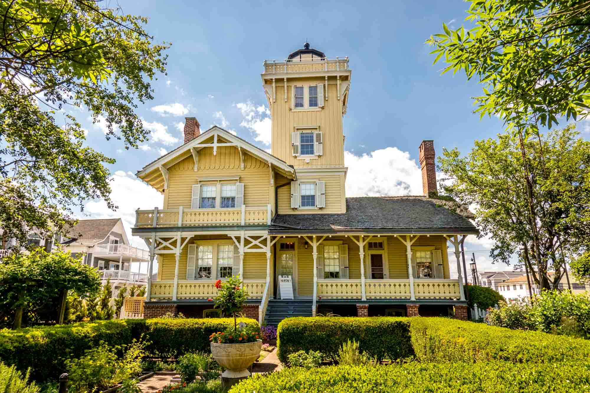 Yellow Victorian-era building with lighthouse tower