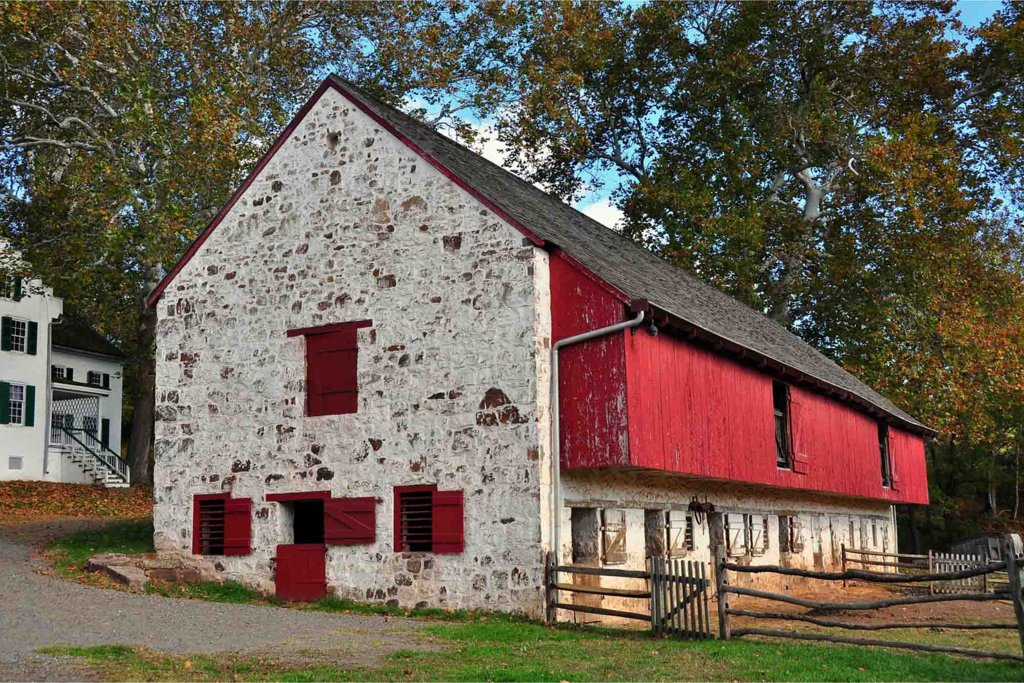 Stone and red barn