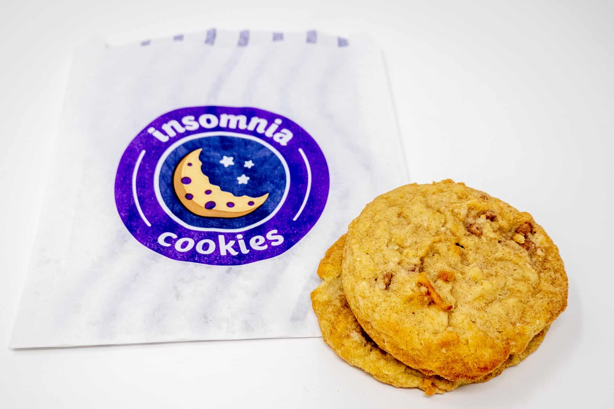 Two cookies and an Insomnia Cookies bag