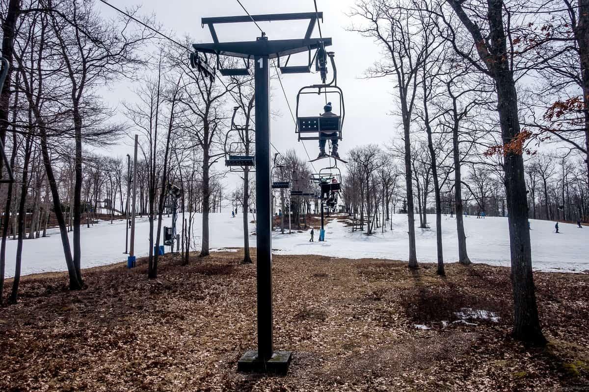 Ski lift and barren ground beneath