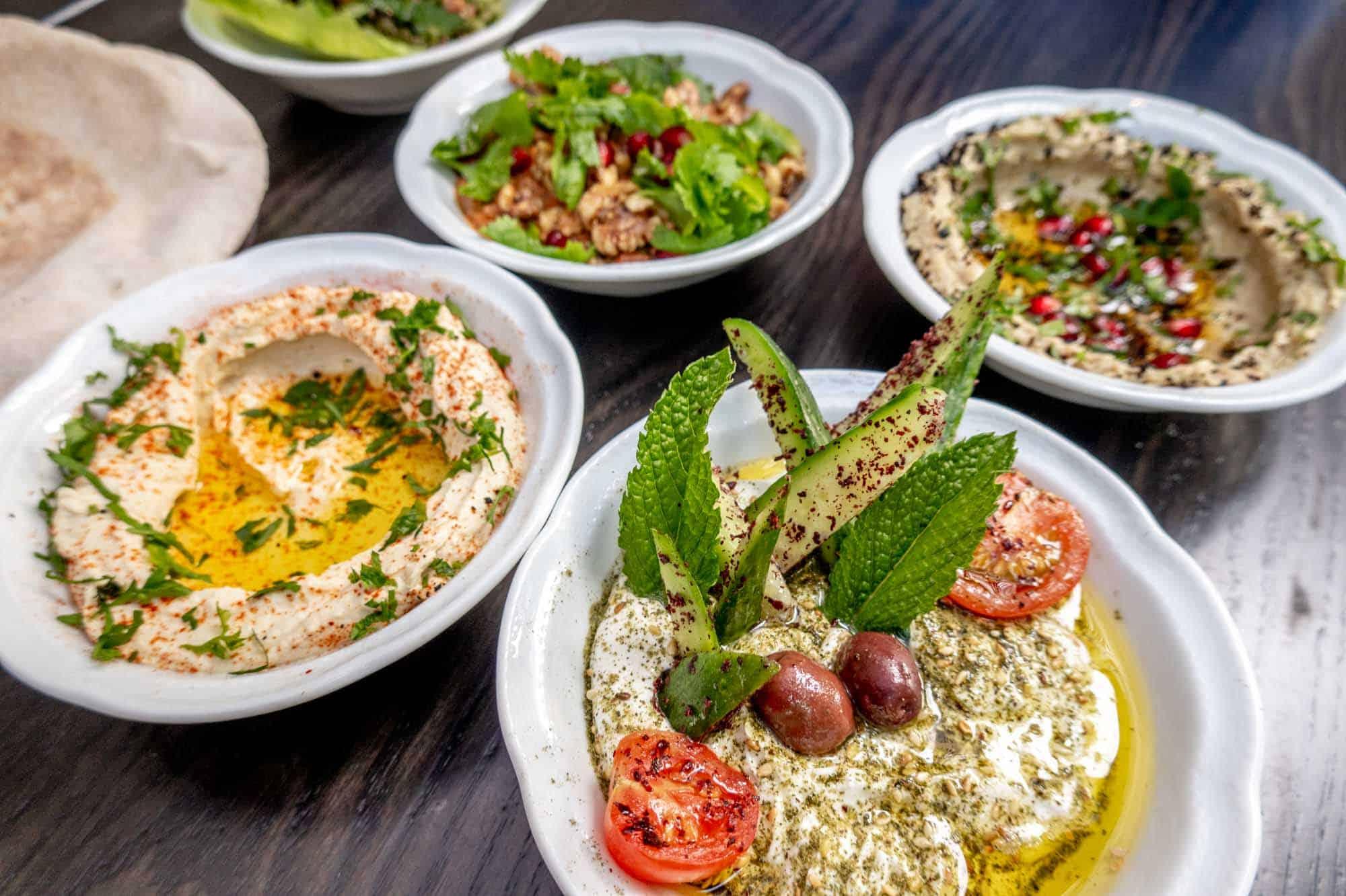 Mezze appetizers in small bowls