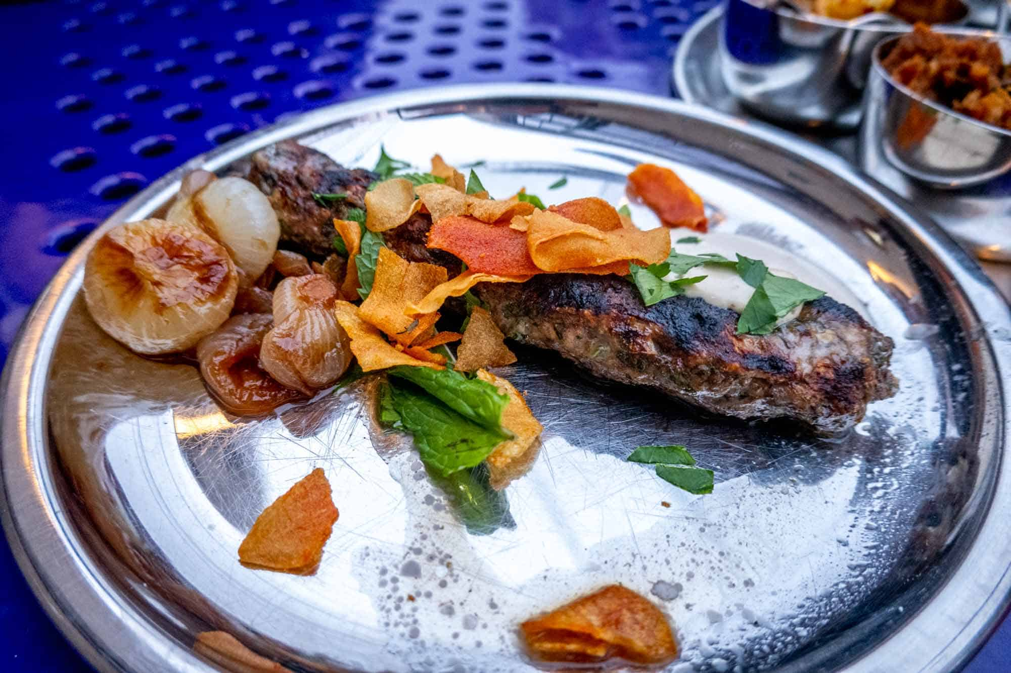 Lamb kofte on steel plate