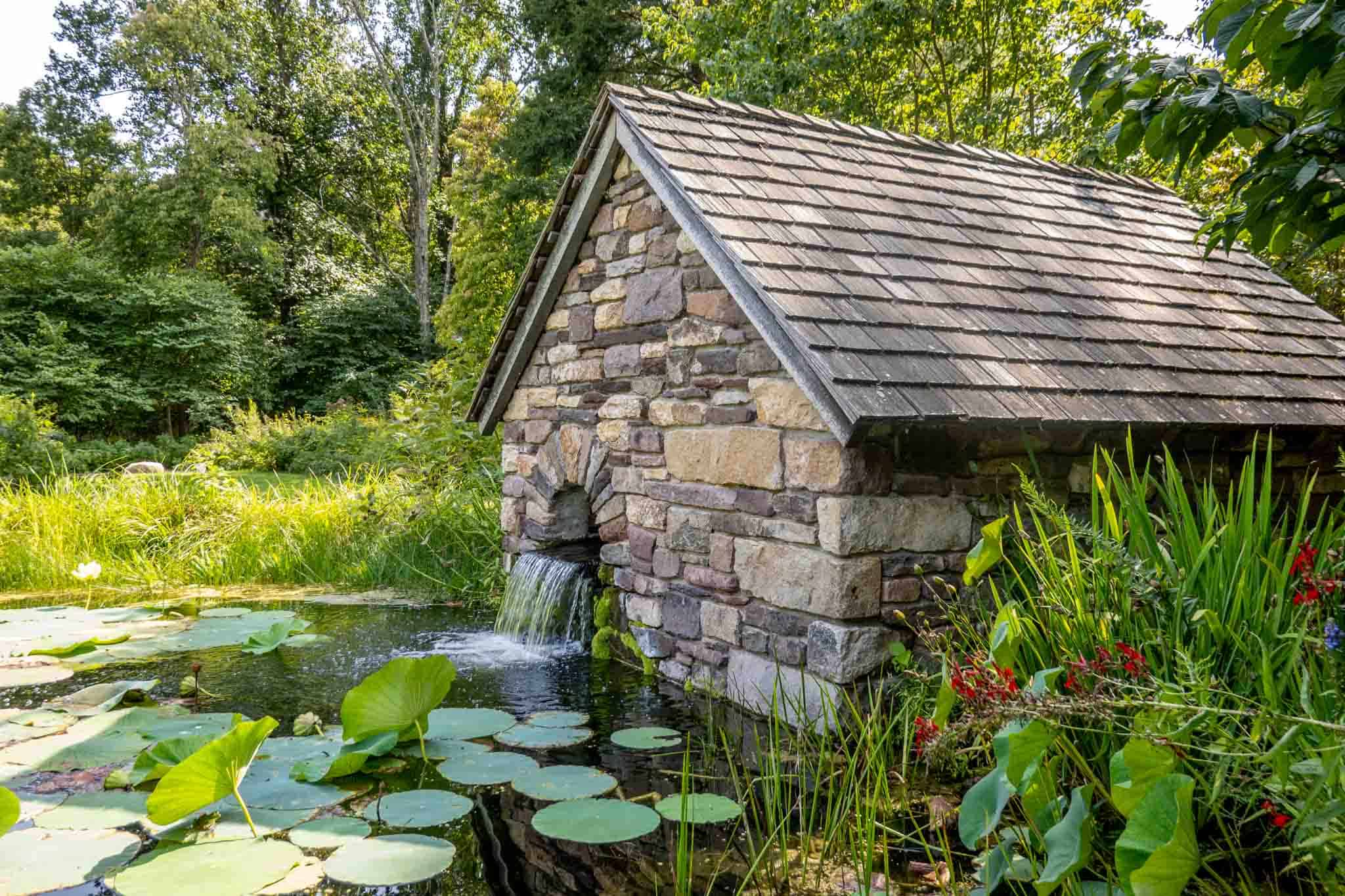 Stone building at pond