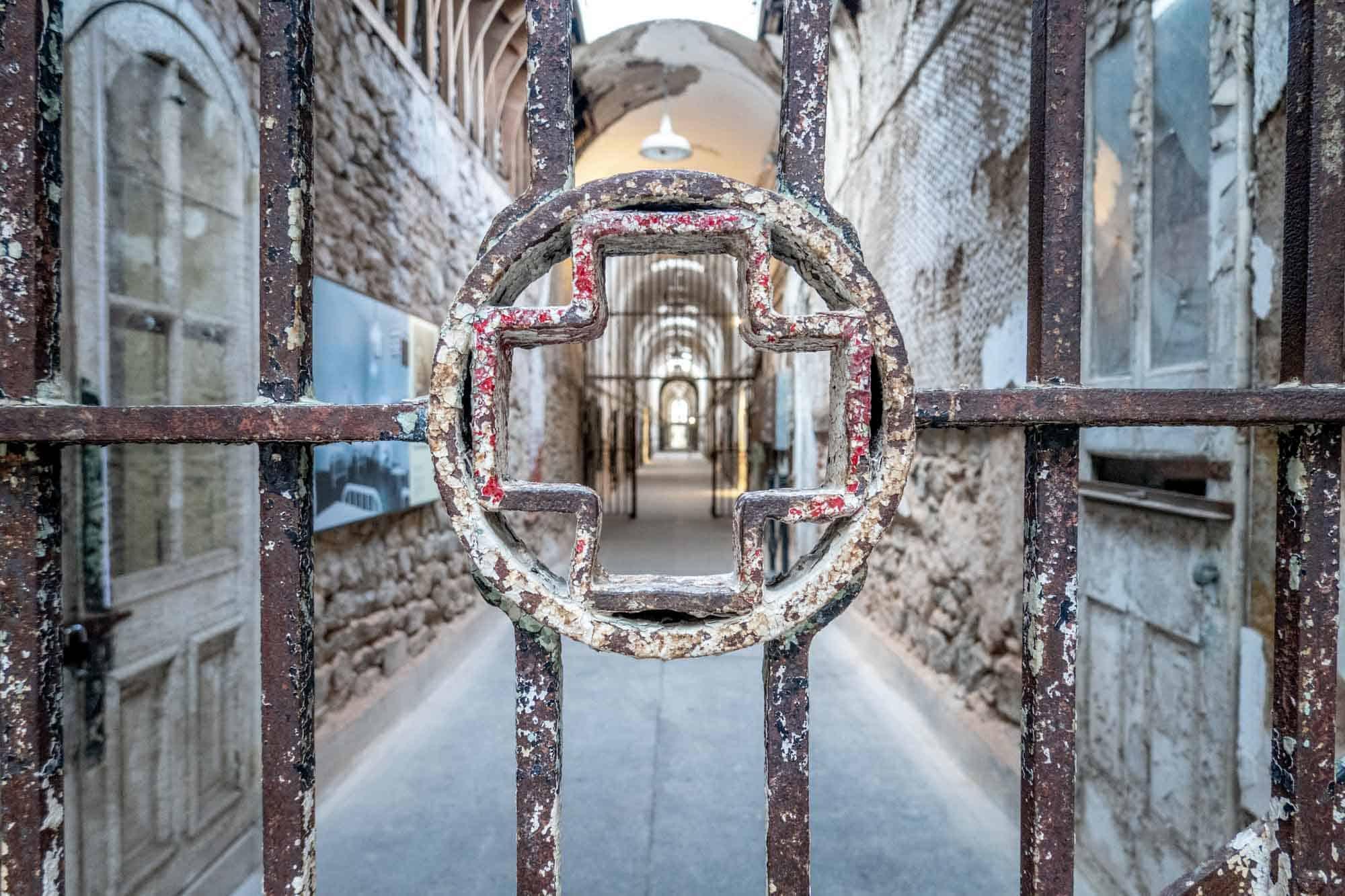 Medical cross in prison cell bars