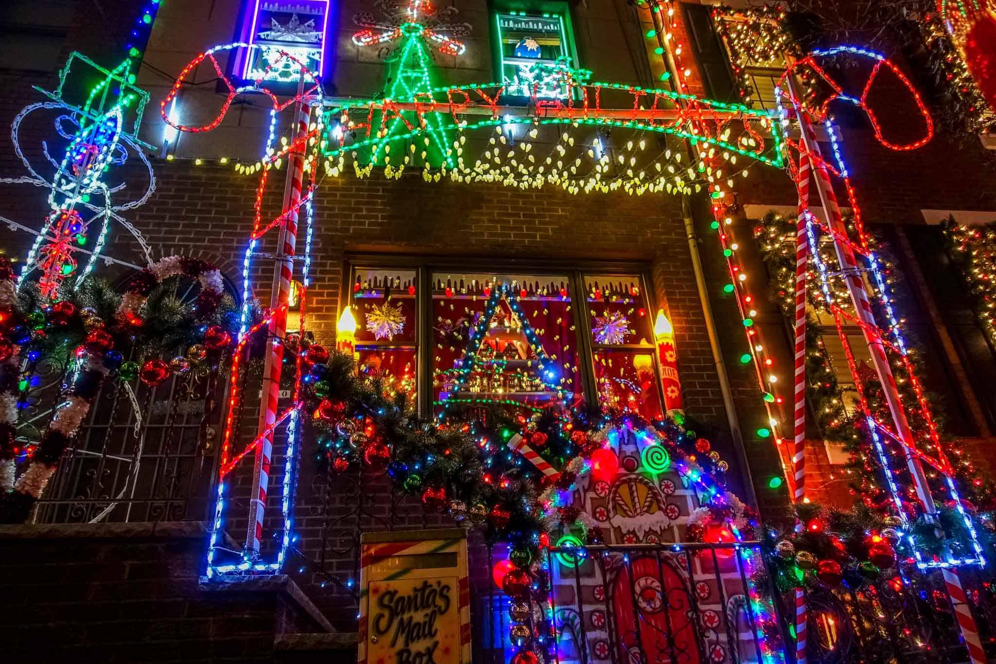 Row home with colorful Christmas lights display