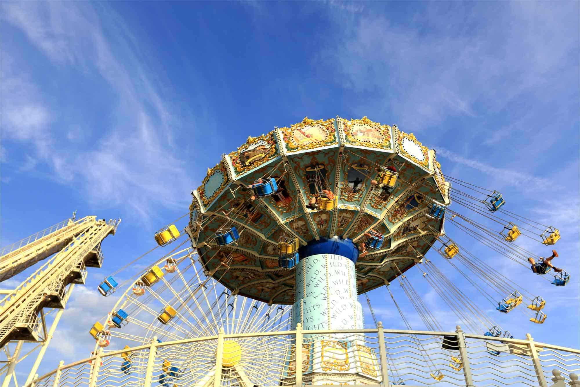 Rotating swing ride at an amusement park