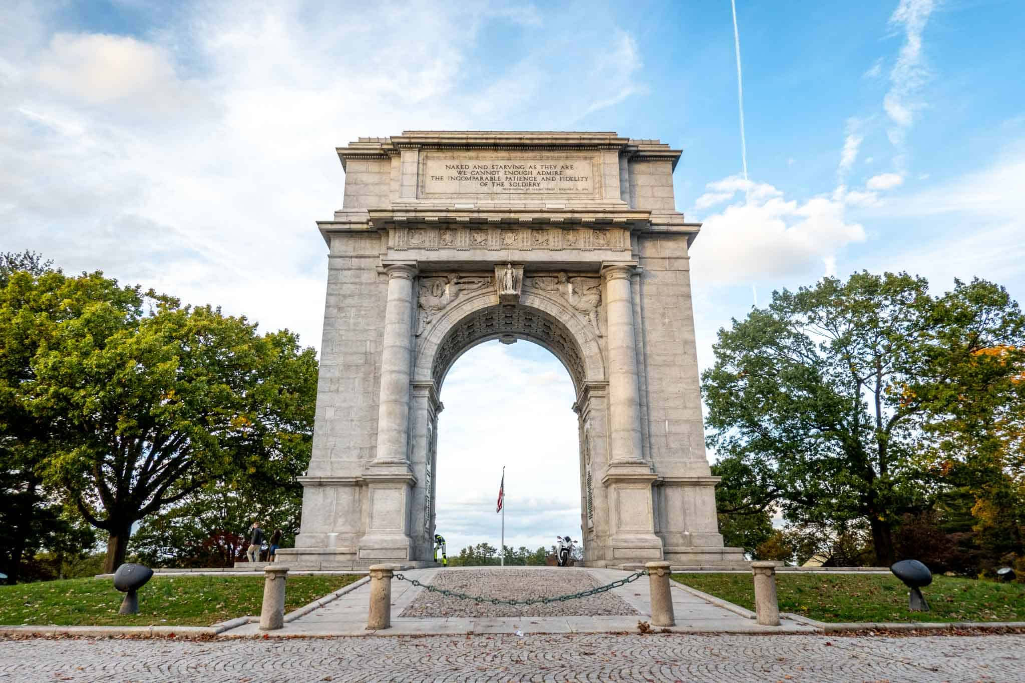 White marble memorial archway