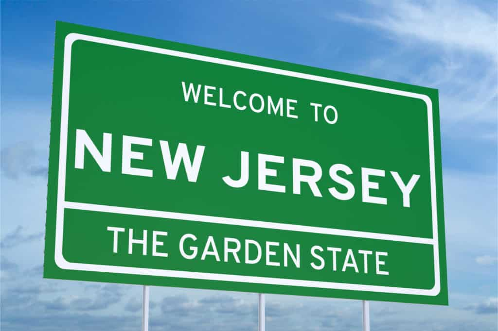 Green sign saying Welcome to New Jersey, the Garden State