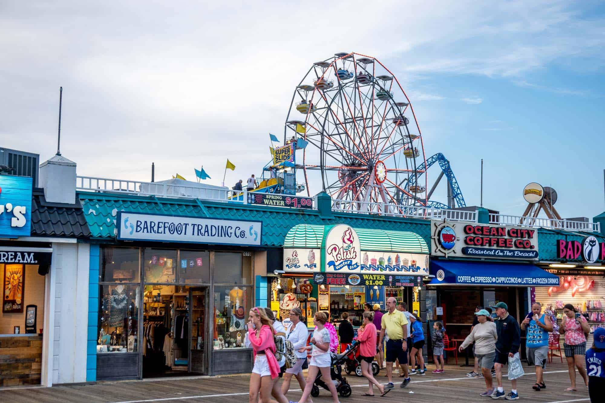 Ferris wheel above businesses on the boardwalk in Ocean City NJ