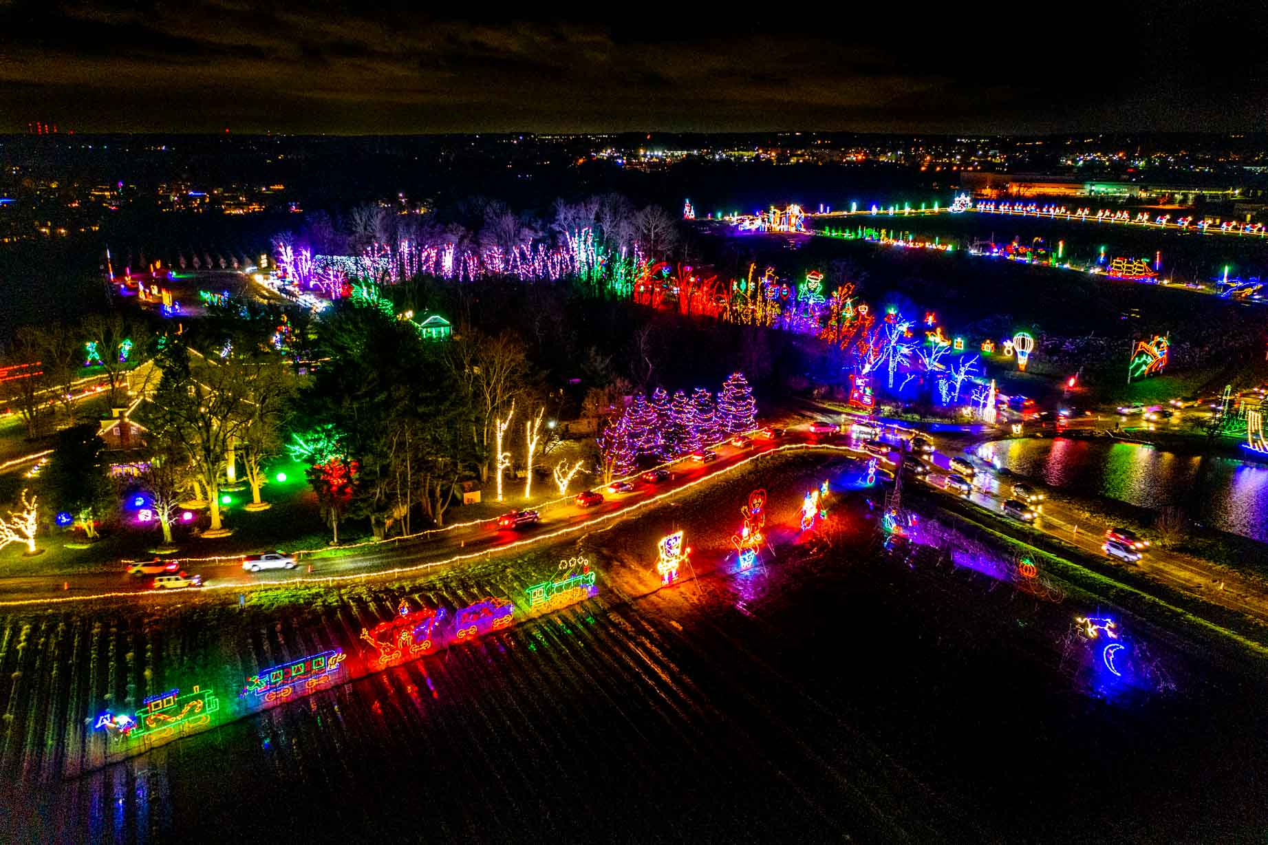 Overhead view of a Christmas light trail lit up at night