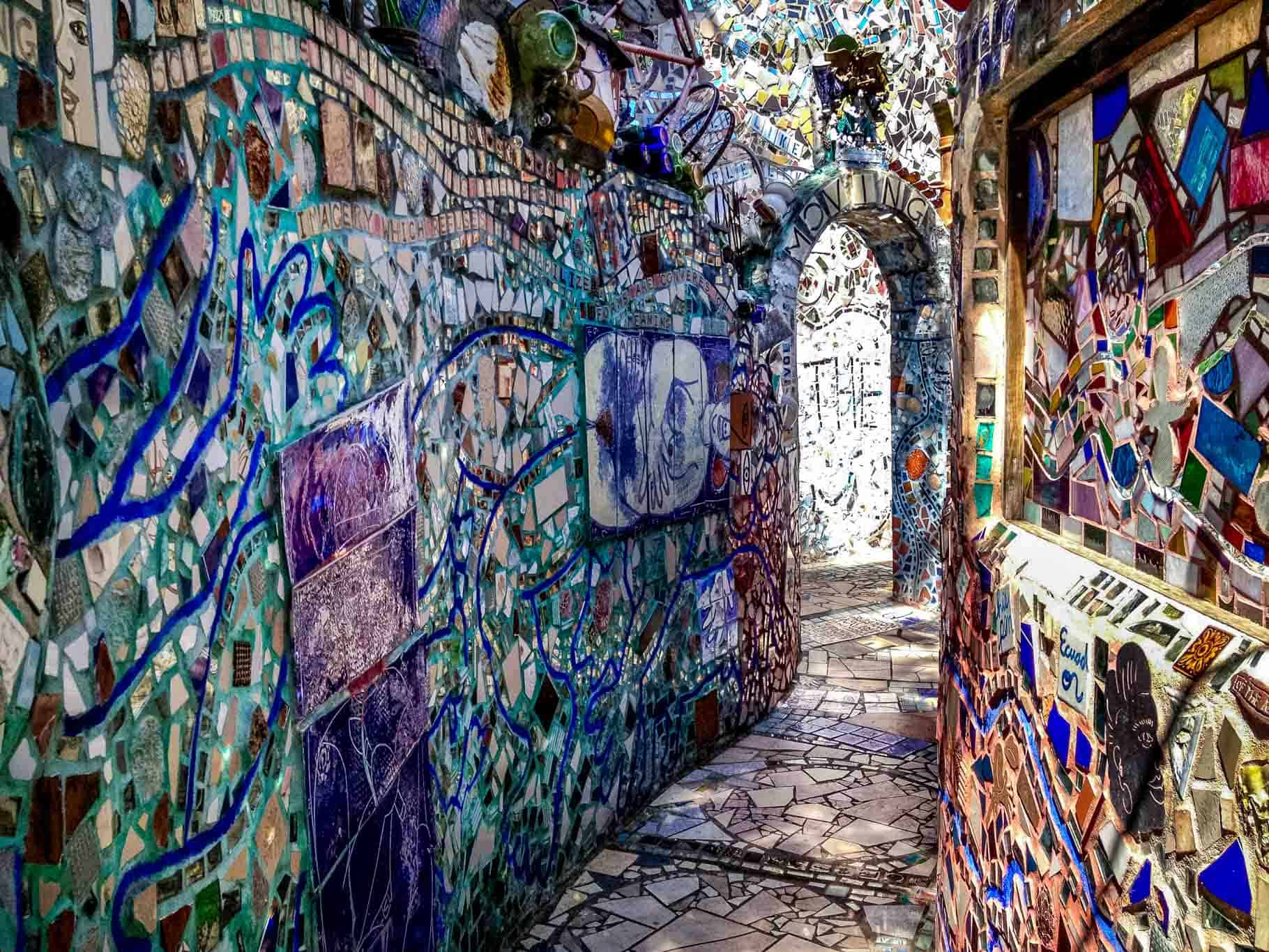 Walls and walkway covered entirely in brightly colored mosaics