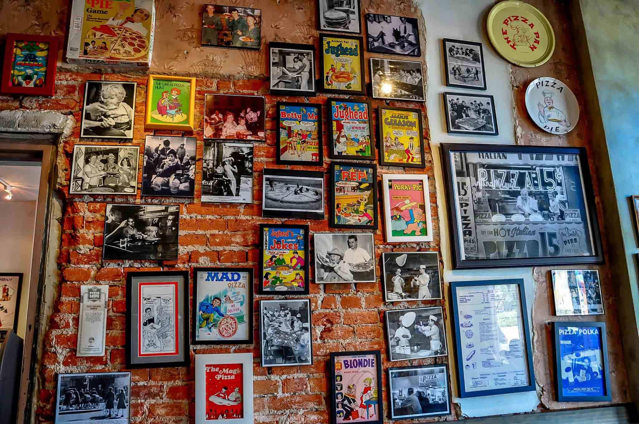 Wall of framed pizza memorabilia