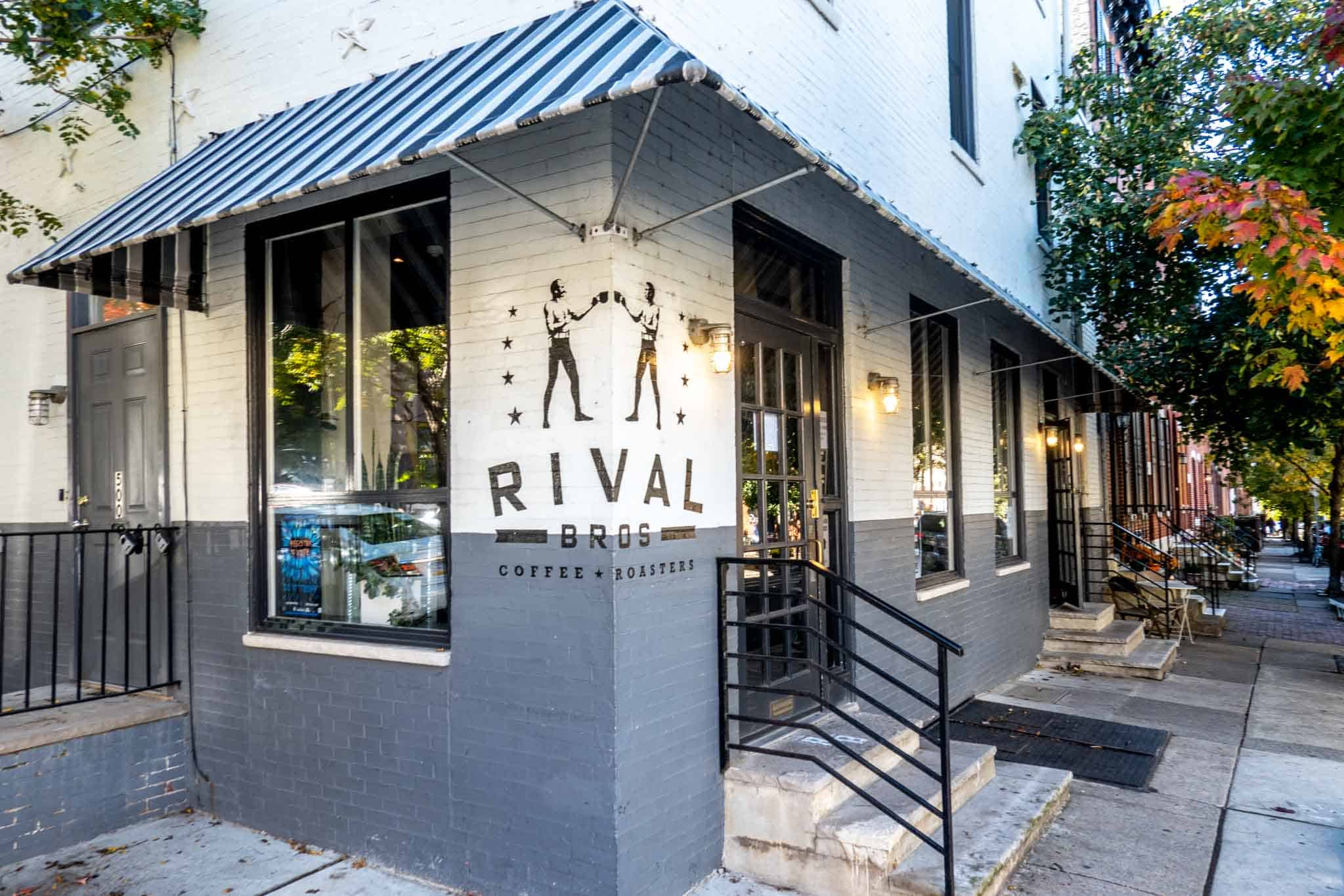 """Exterior of a brick building with a sign for """"Rival Bros Coffee Roasters"""""""