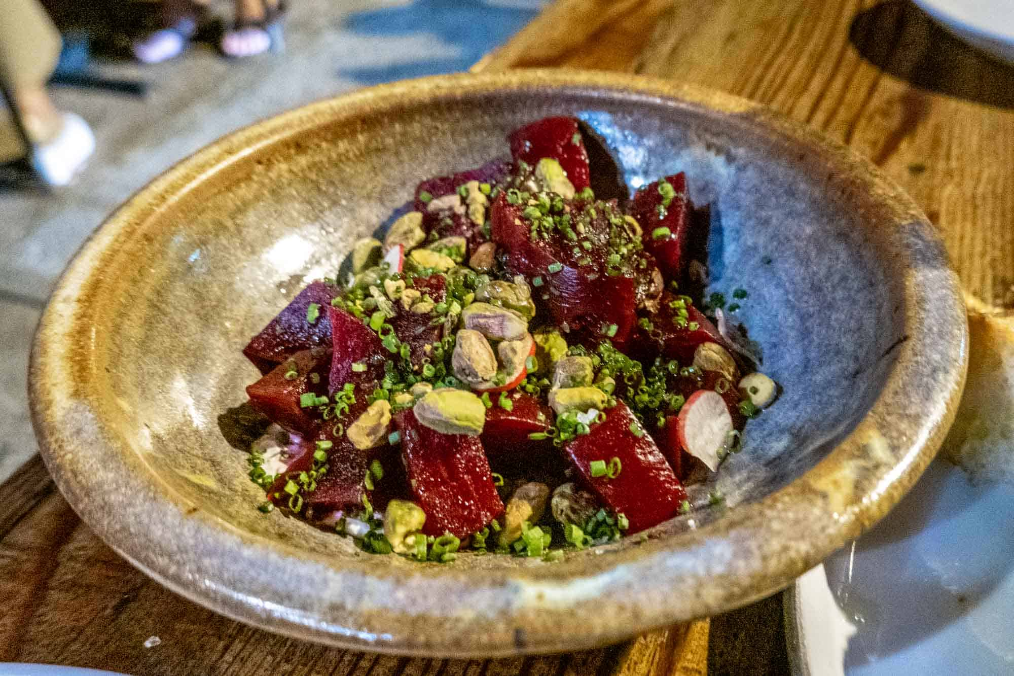 Roasted beets and pistachios in bowl