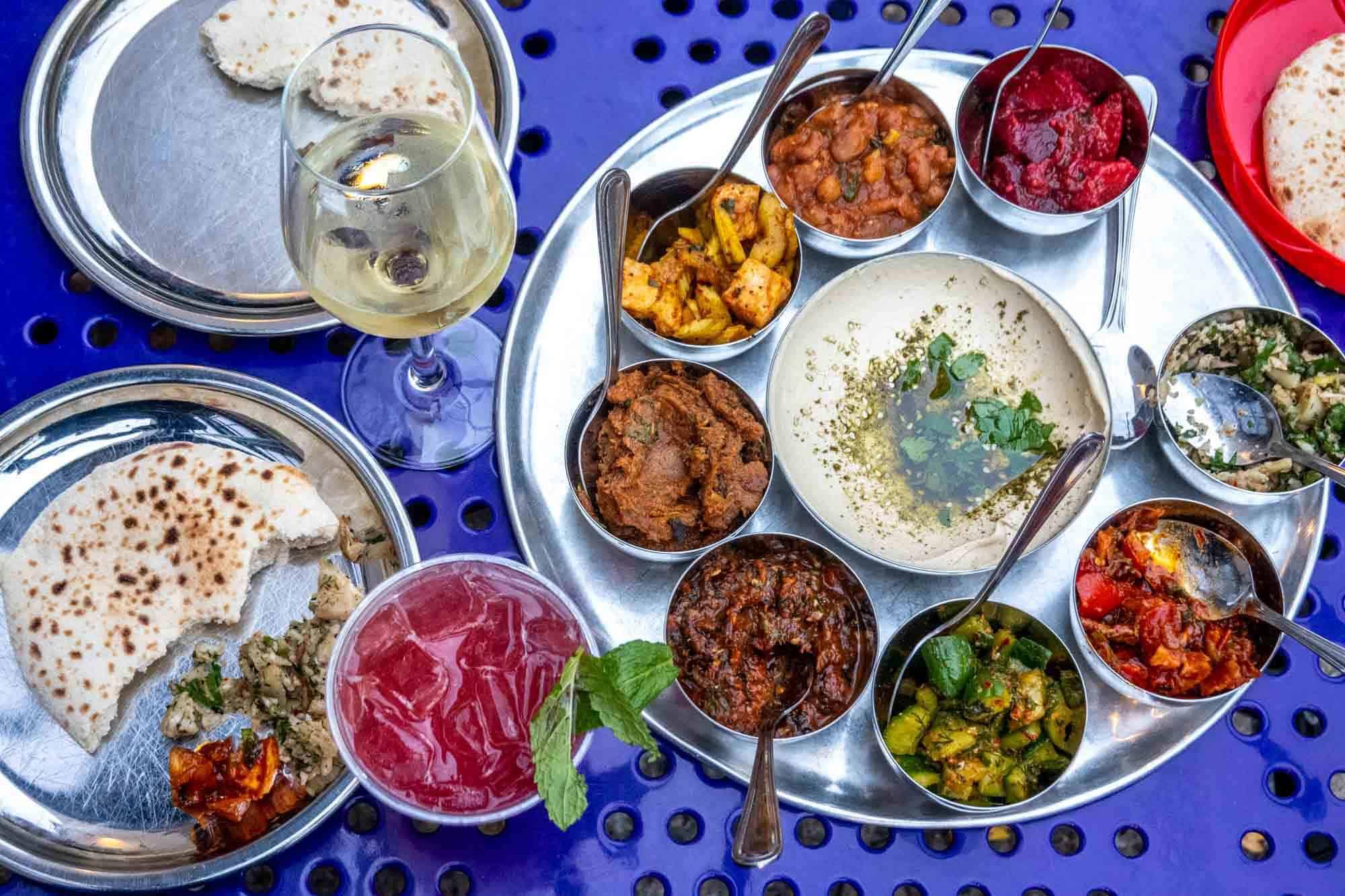 Salatim and cocktails on steel plates