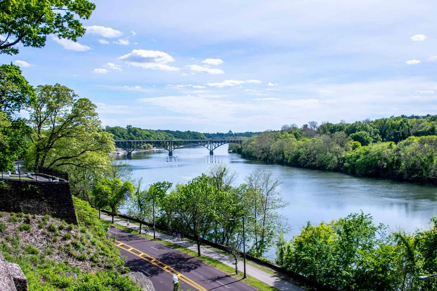 Overhead view of the Schuylkill River crossed by a bridge in the distance