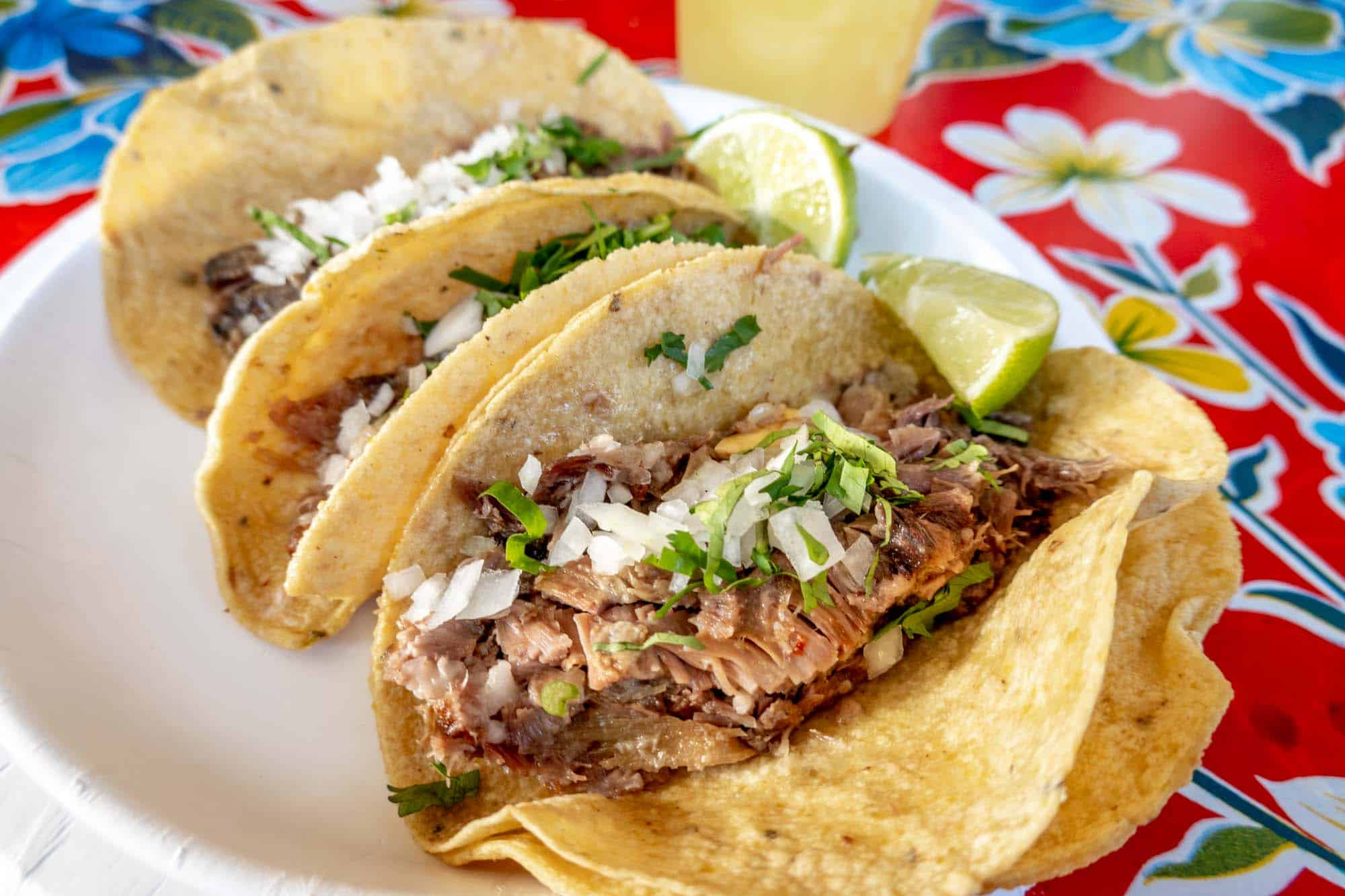 Meat tacos topped with onion and cilantro