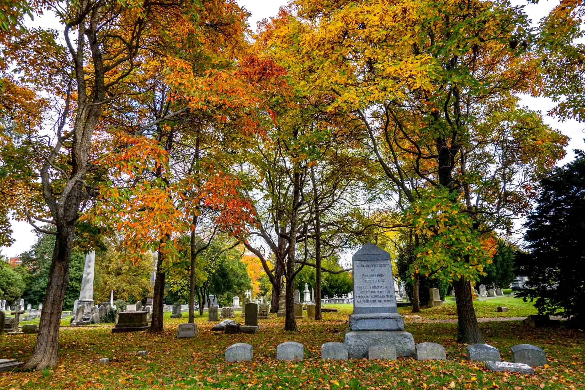Bright fall foliage over gravestones
