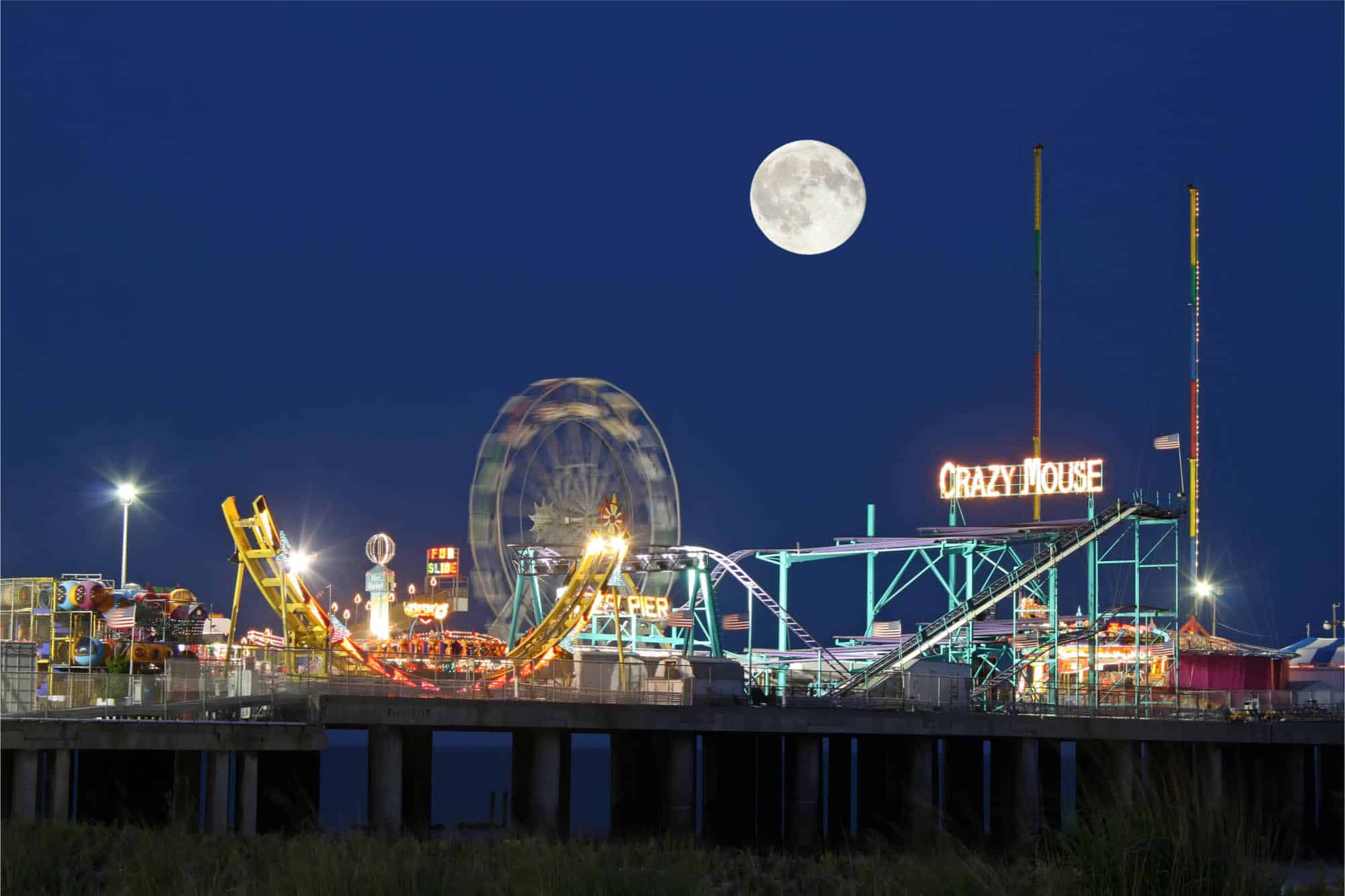 Moon over amusement park rides