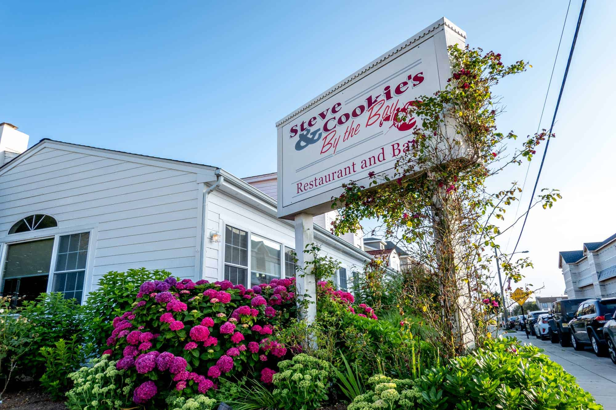 Exterior of Steve & Cookies restaurant with flowers