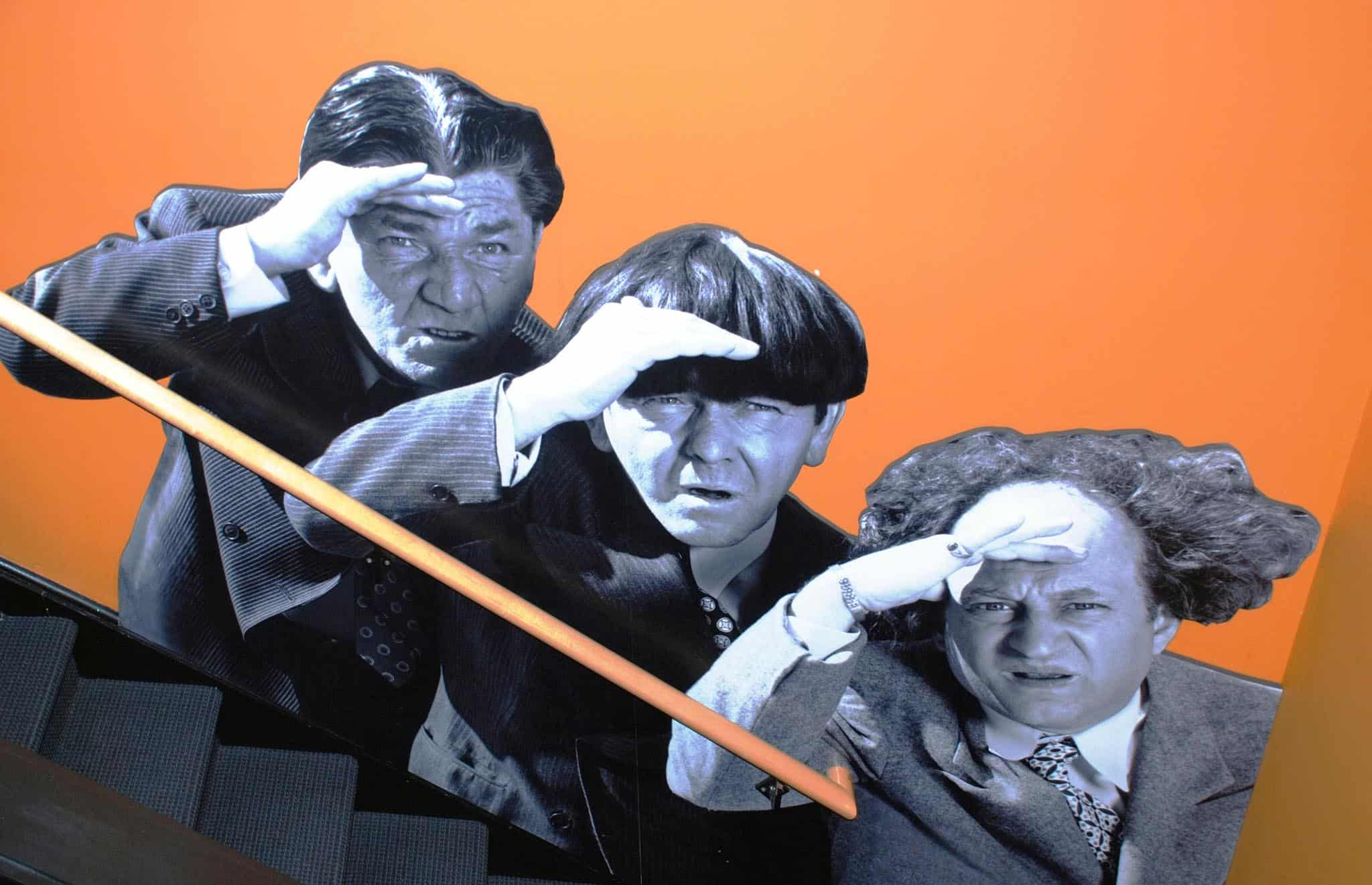 The Three Stooges painted into the stairwell at the Stoogeum