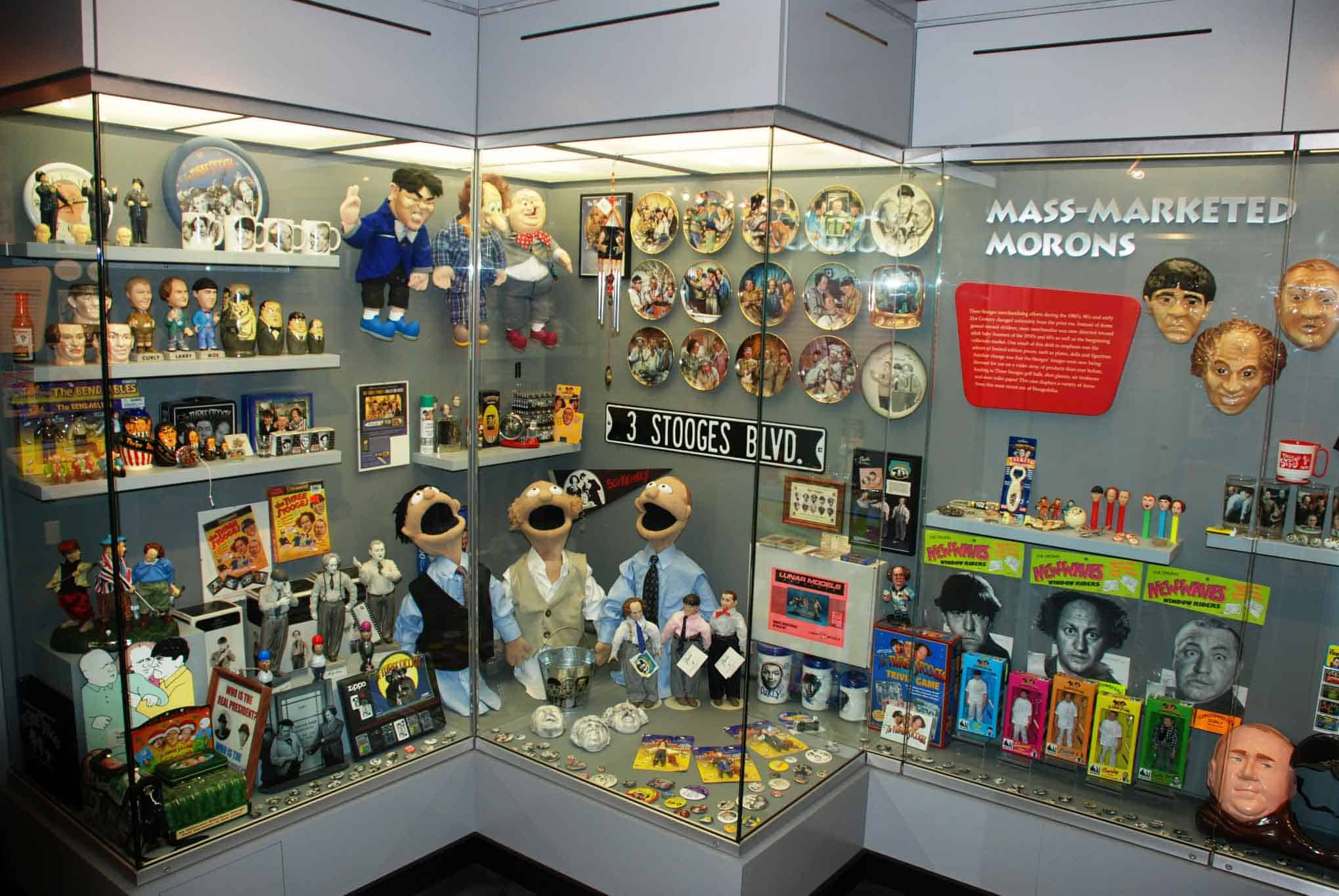 Display cases of show merchandise and collectibles.
