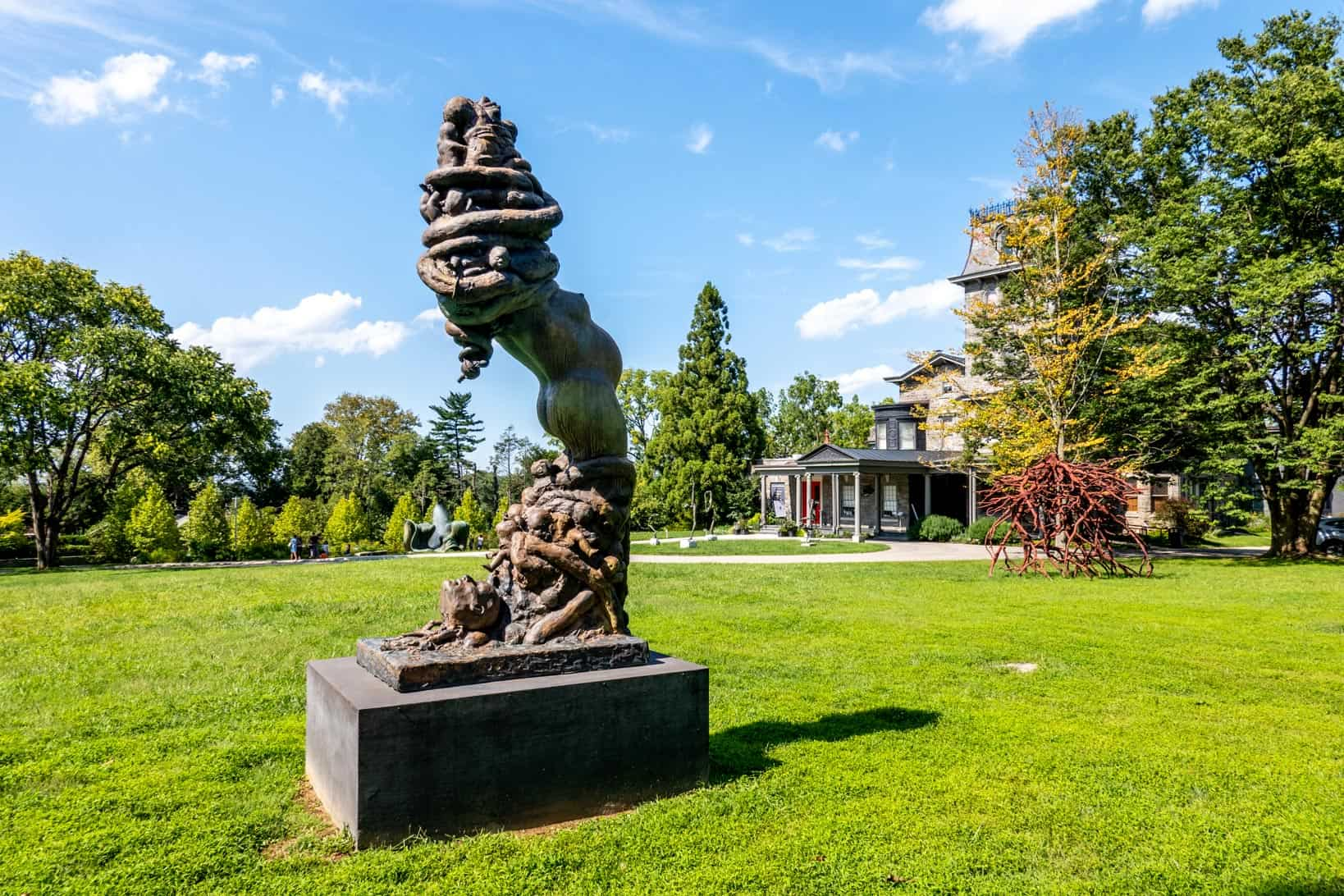 Abstract statue with human torso on the grounds of an art museum