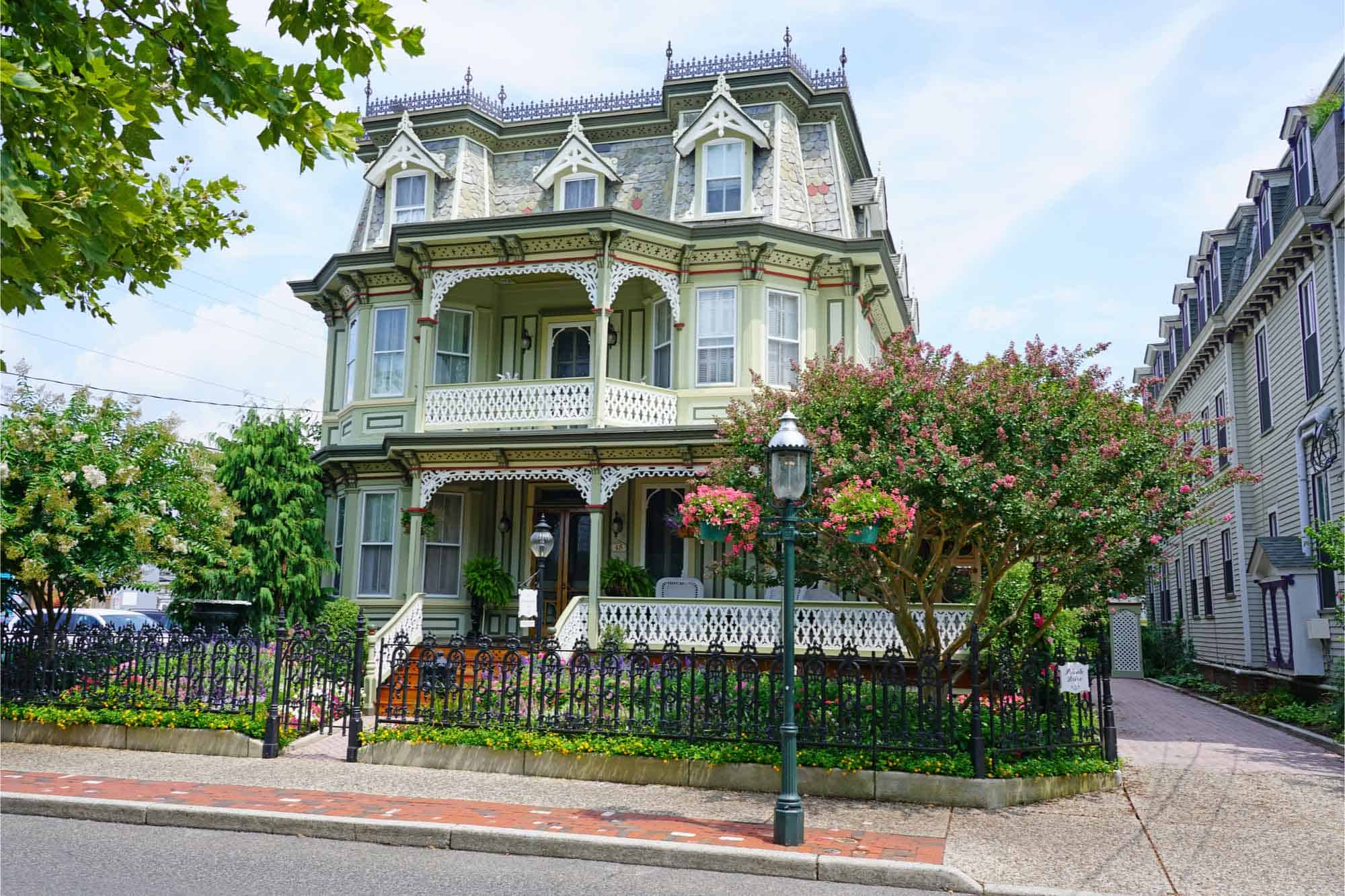 Green, three-story Victorian mansion in New Jersey