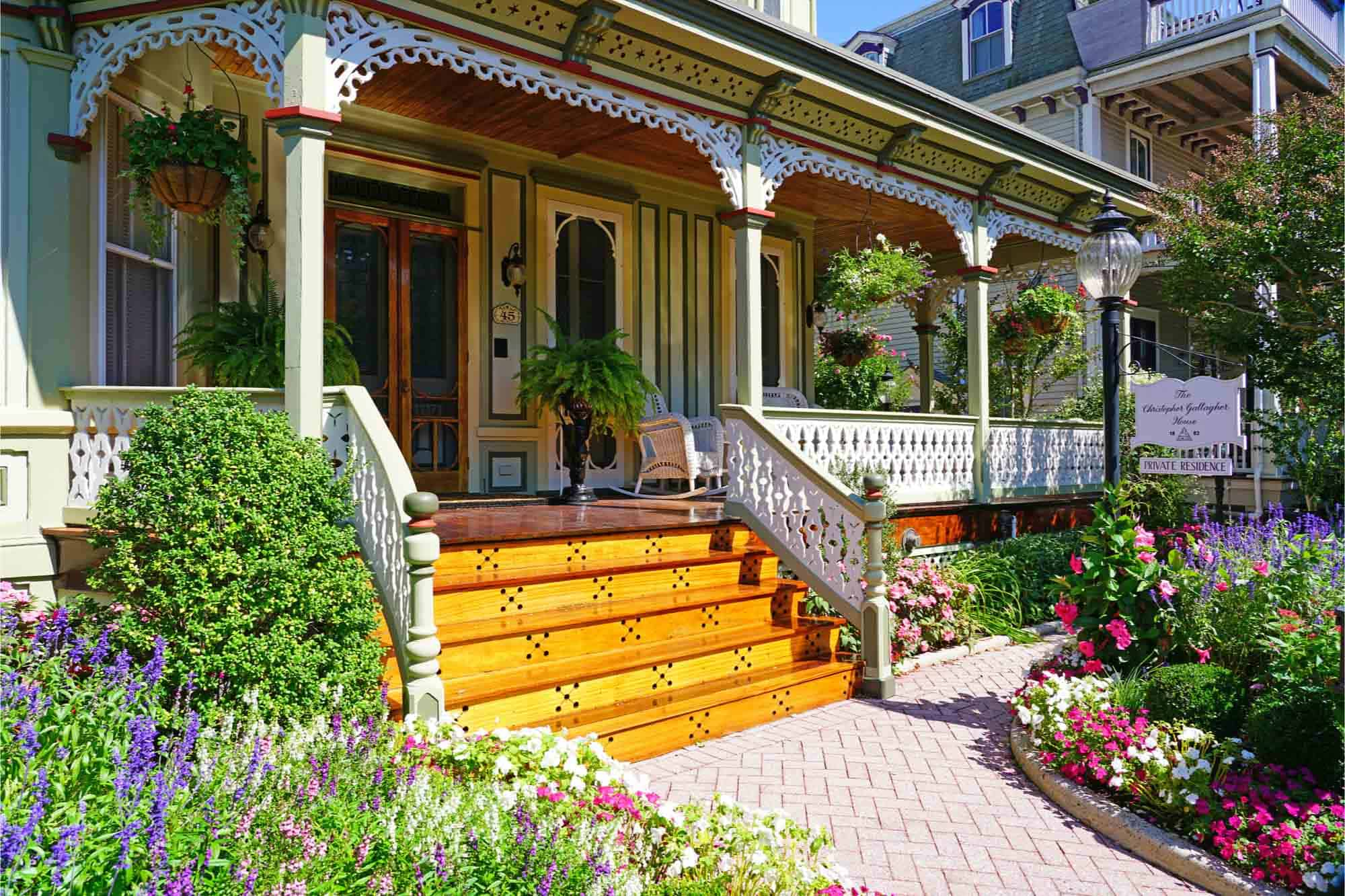 Colorful flower garden in front of Victorian home